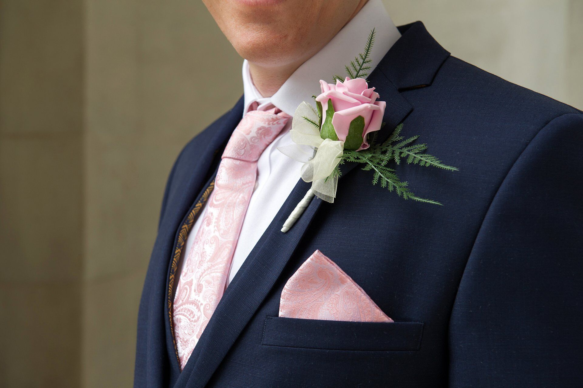 groom in navy and pink mayfair library wedding photographer westminster registry office