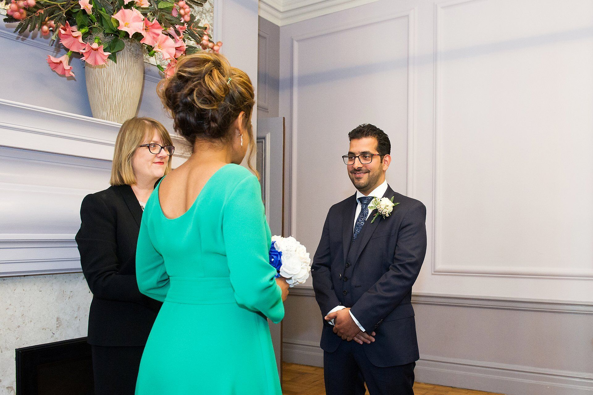 groom smiling at bride in green wedding dress during knightsbridge room wedding photography old marylebone town hall