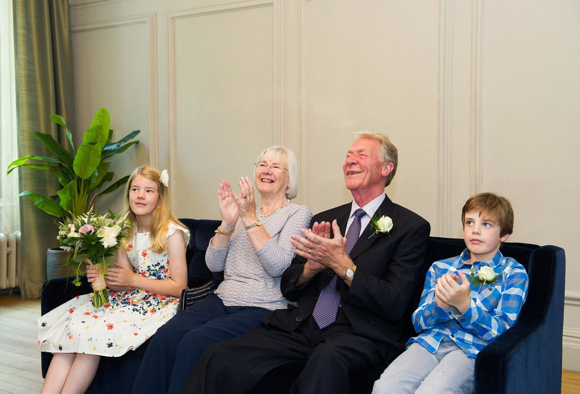 soho room wedding photography and guests applauding the bride and groom after they have said their vows