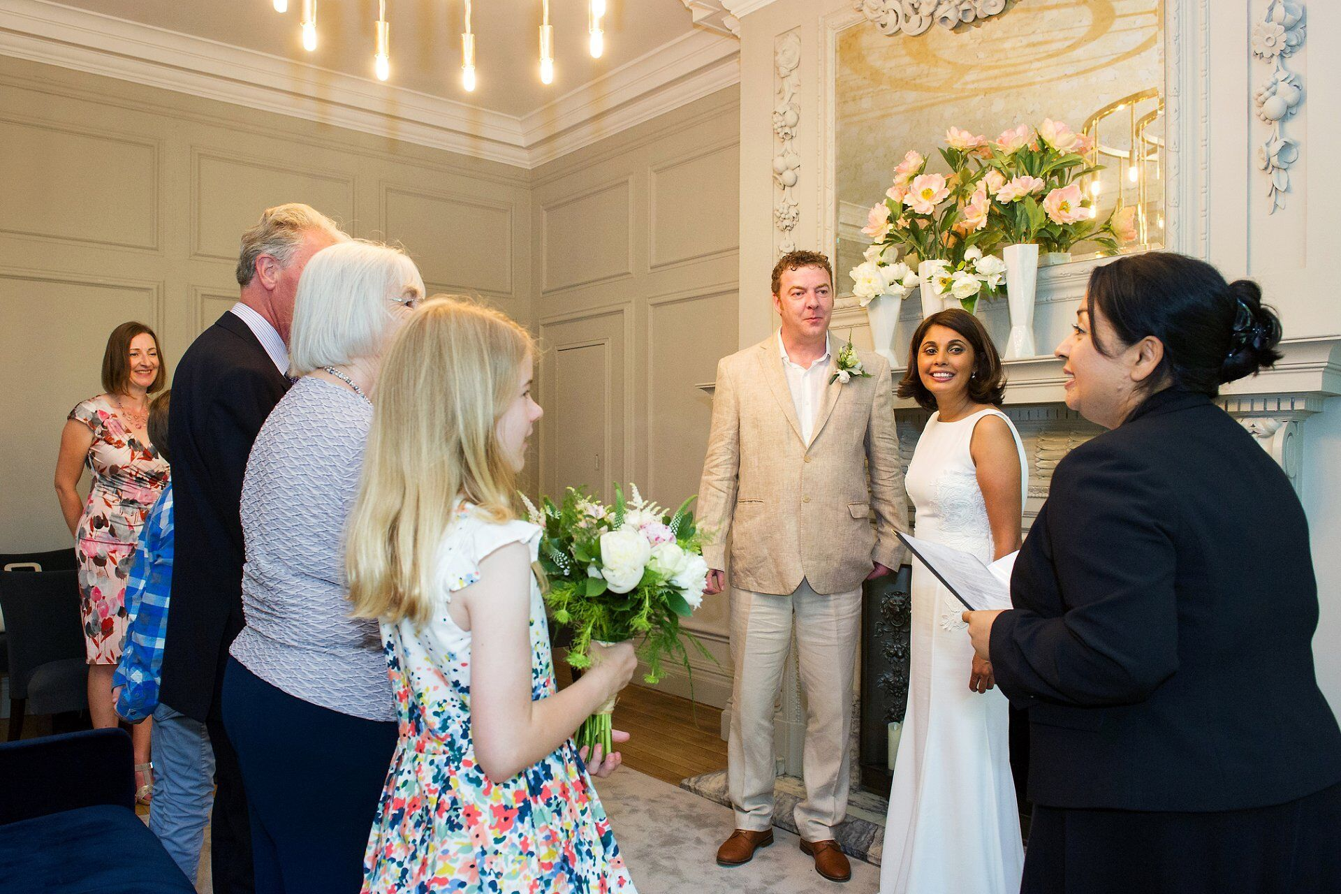 westminster registrar welcomes bride and groom and their guests to the soho room at old marylebone town hall