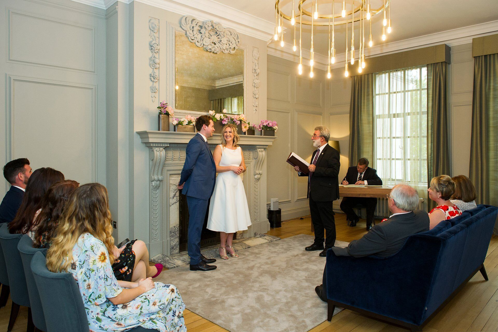soho room wedding photography and a ceremony in progress at old marylebone town hall wedding photography by emma duggan