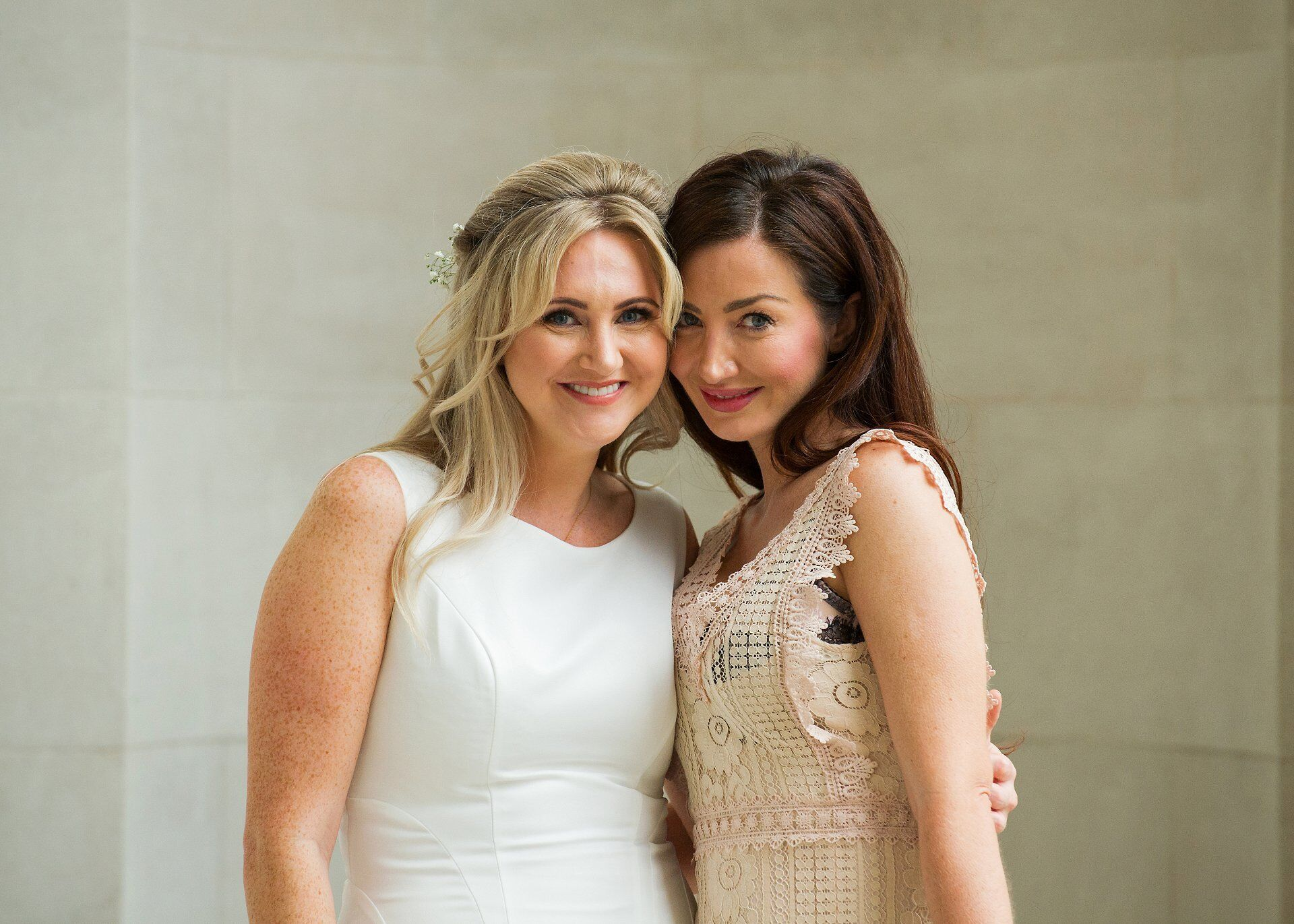 bride and best friend at old marylebone town hall just before soho room ceremony