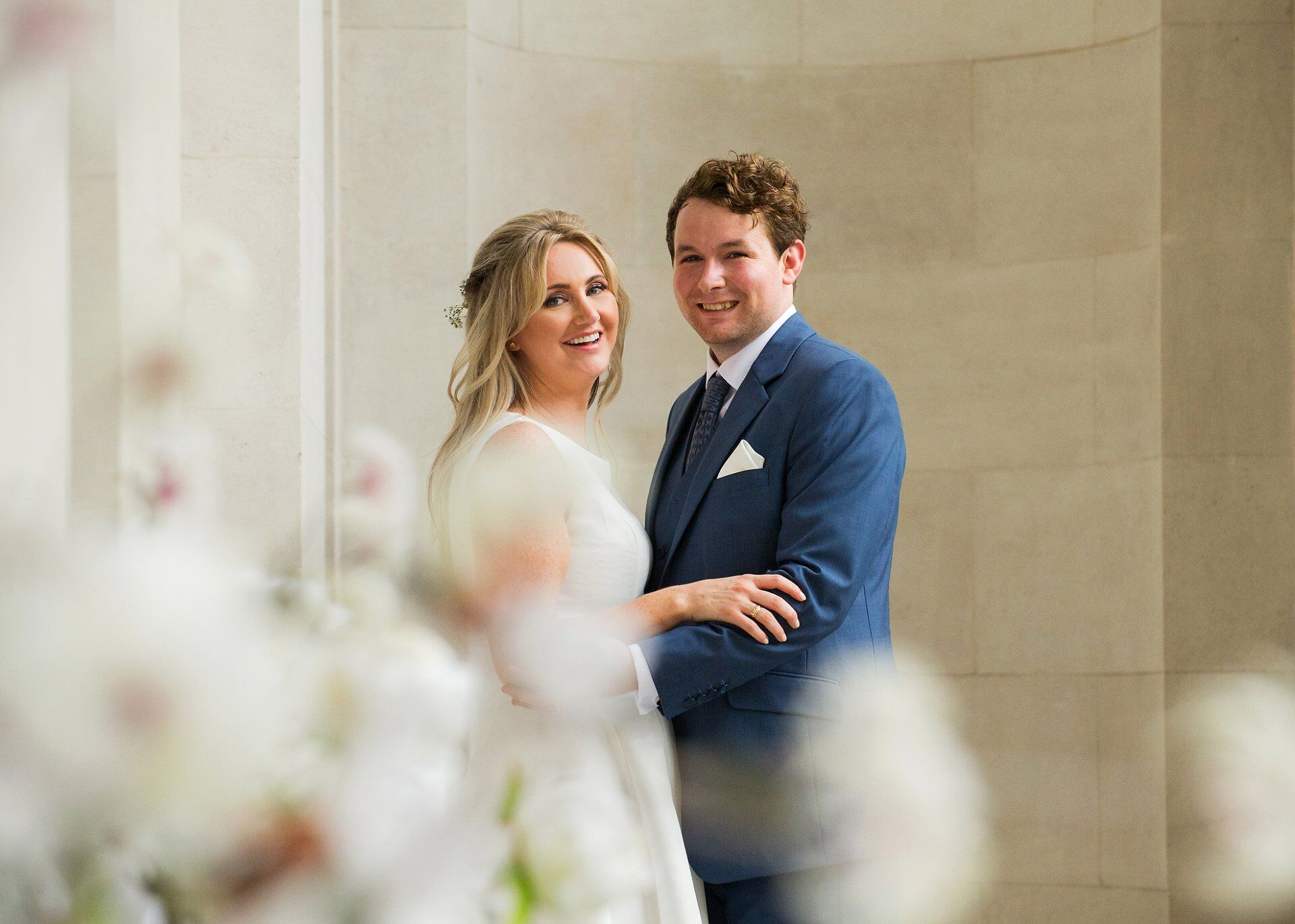 bride and groom by old marylebone town hall wedding photographer emma duggan (soho room wedding photography)
