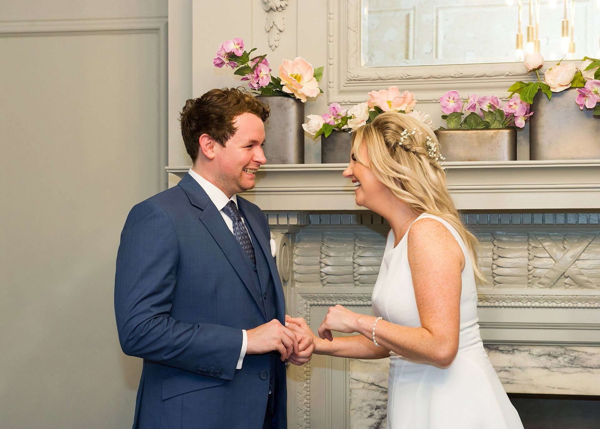 bride and groom smiling during ring exchange at civil marriage westminster register office