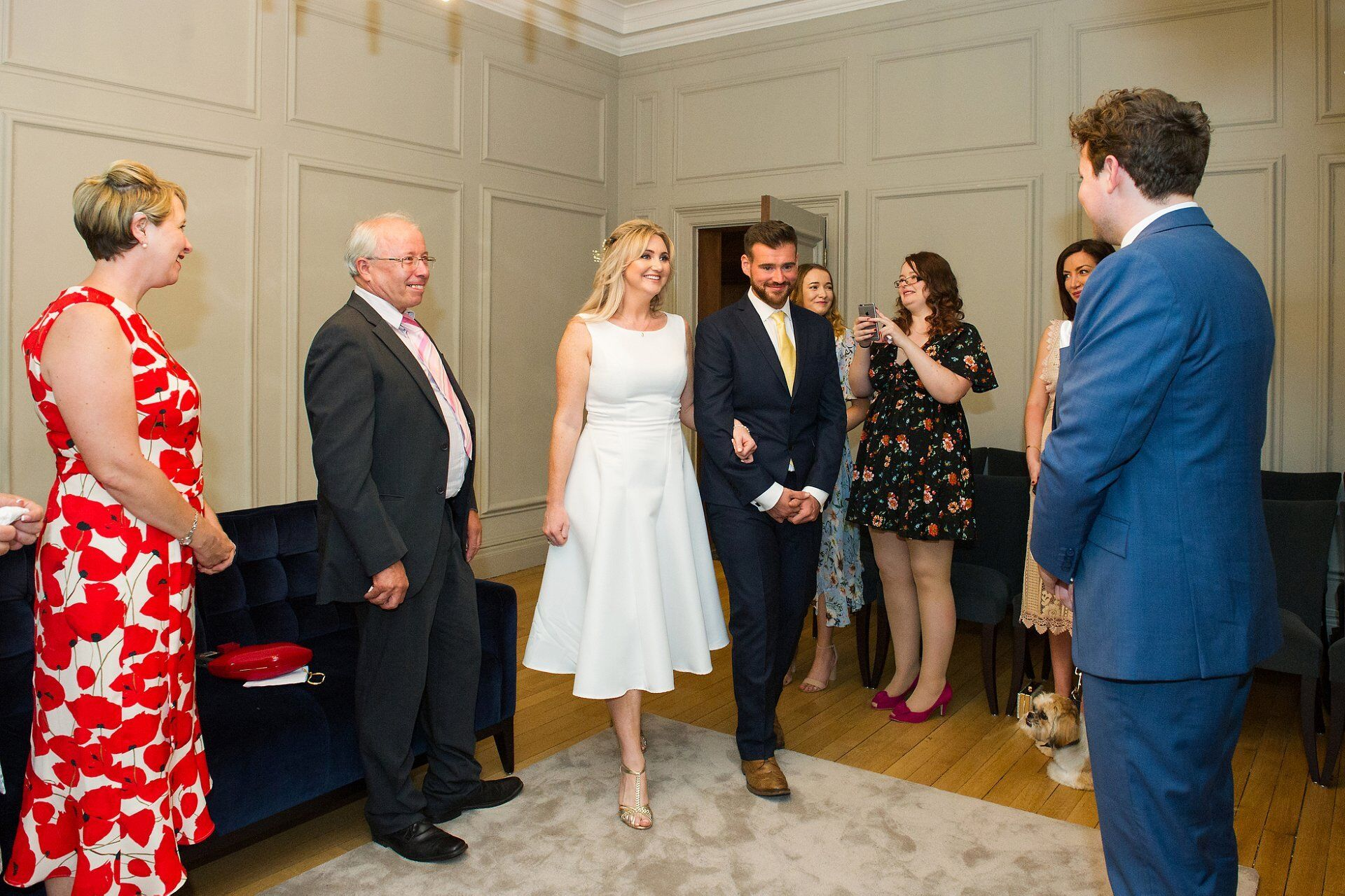 bride and her brother walk into the soho room at the start of westminster register office civil ceremony