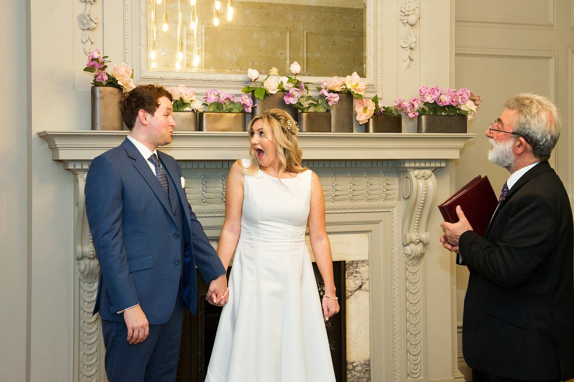 bride excited at being officially married at old marylebone town hall (soho room wedding photography) the main home of westminster register office weddings