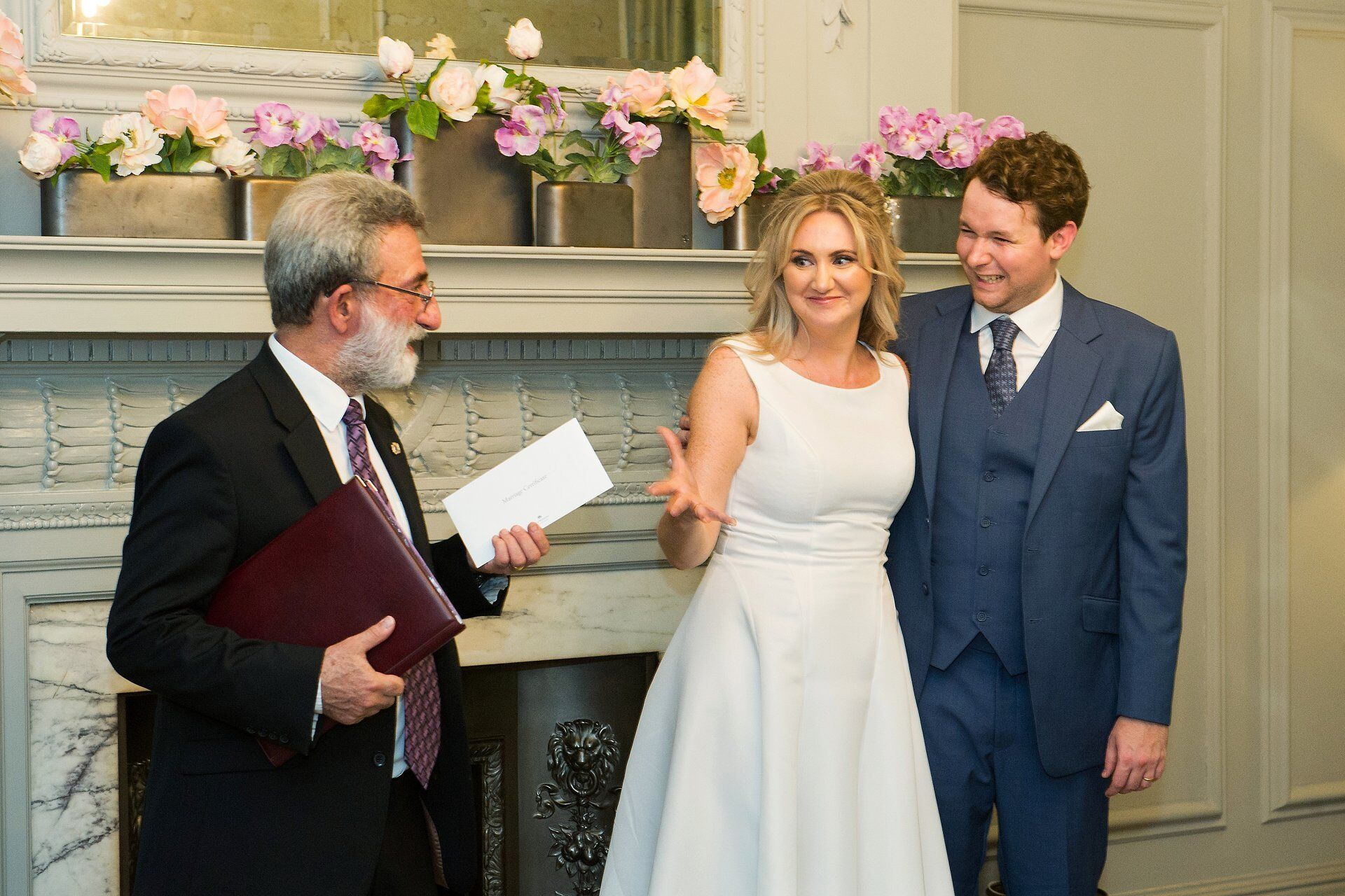 old marylebone town hall wedding photographer emma duggan captures a bride showing her eagerness to receive her marriage certificate from westminster register office superintendent registrar