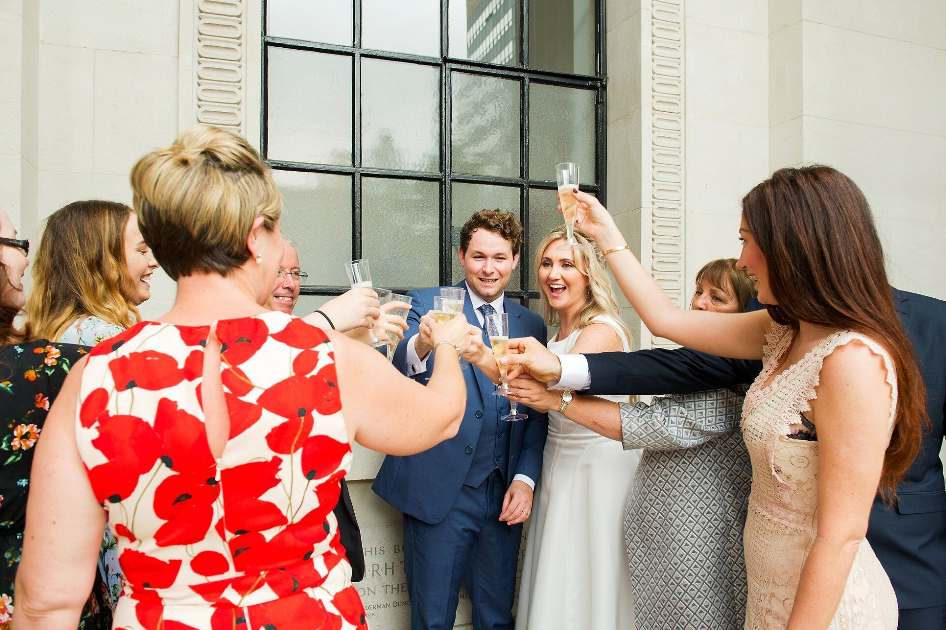 celebrating wedding at old marylebone town hall with champagne