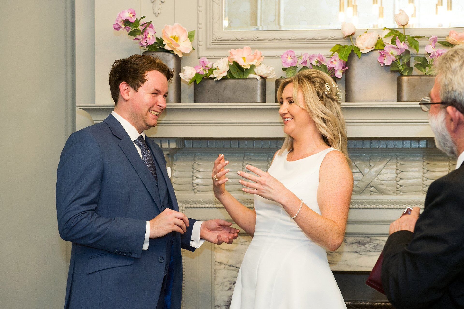 groom and bride laughing during their soho room summer wedding