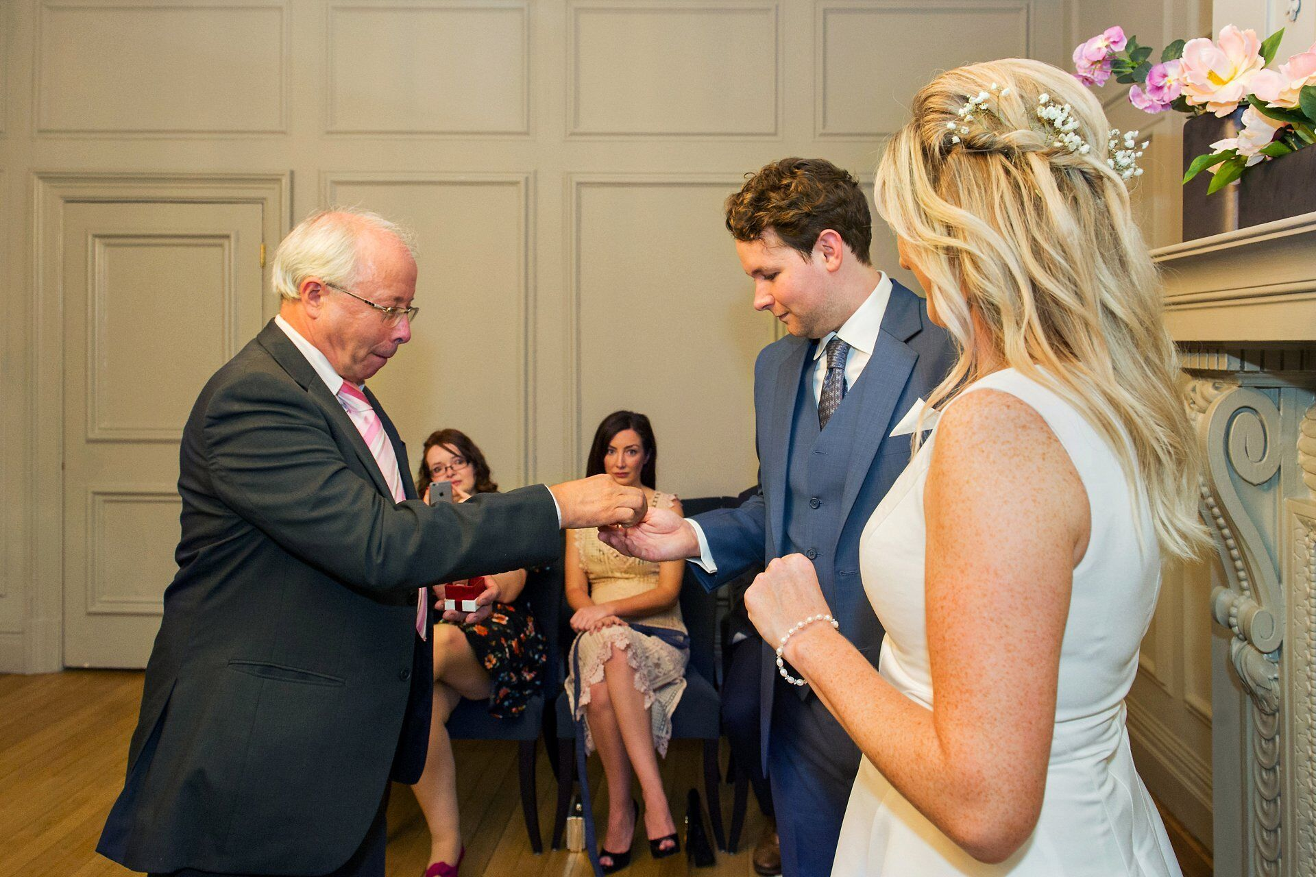groom's father delivering the rings during this soho room wedding ceremony