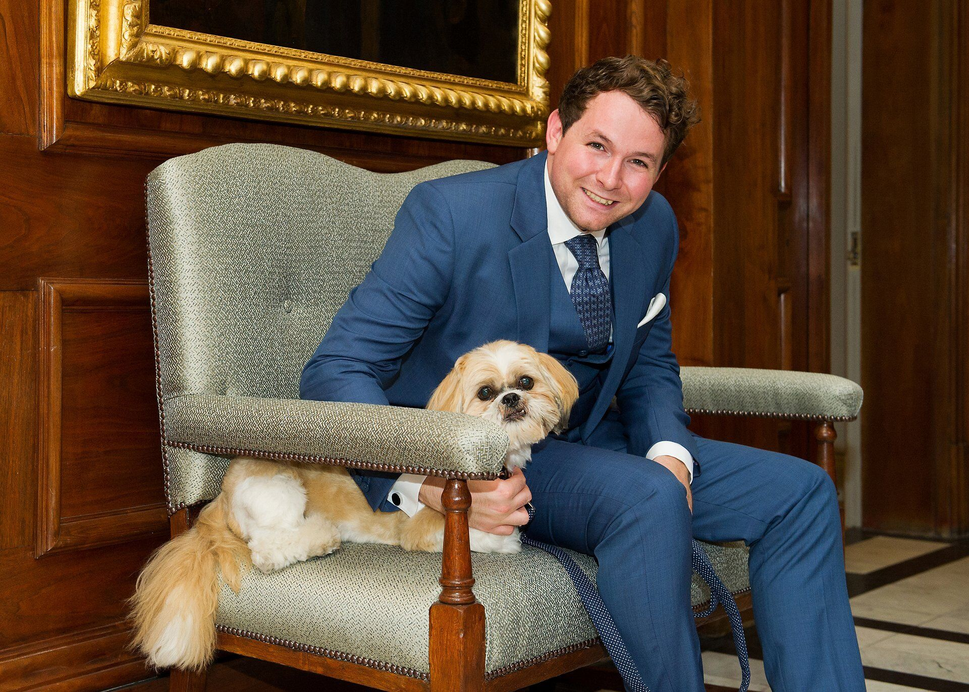 old marylebone town hall wedding dogs a groom with his dog jasper outside the soho room