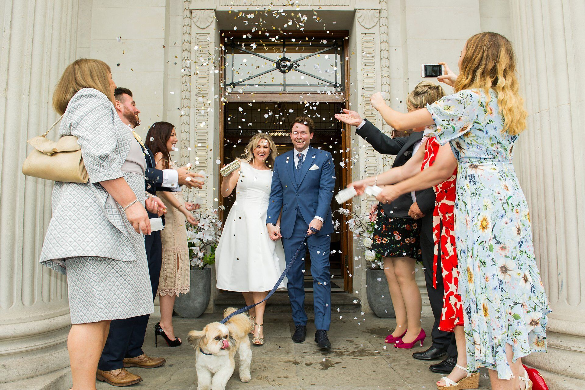 old marylebone town hall wedding dogs and confetti with owners as they leave after their soho room wedding ceremony