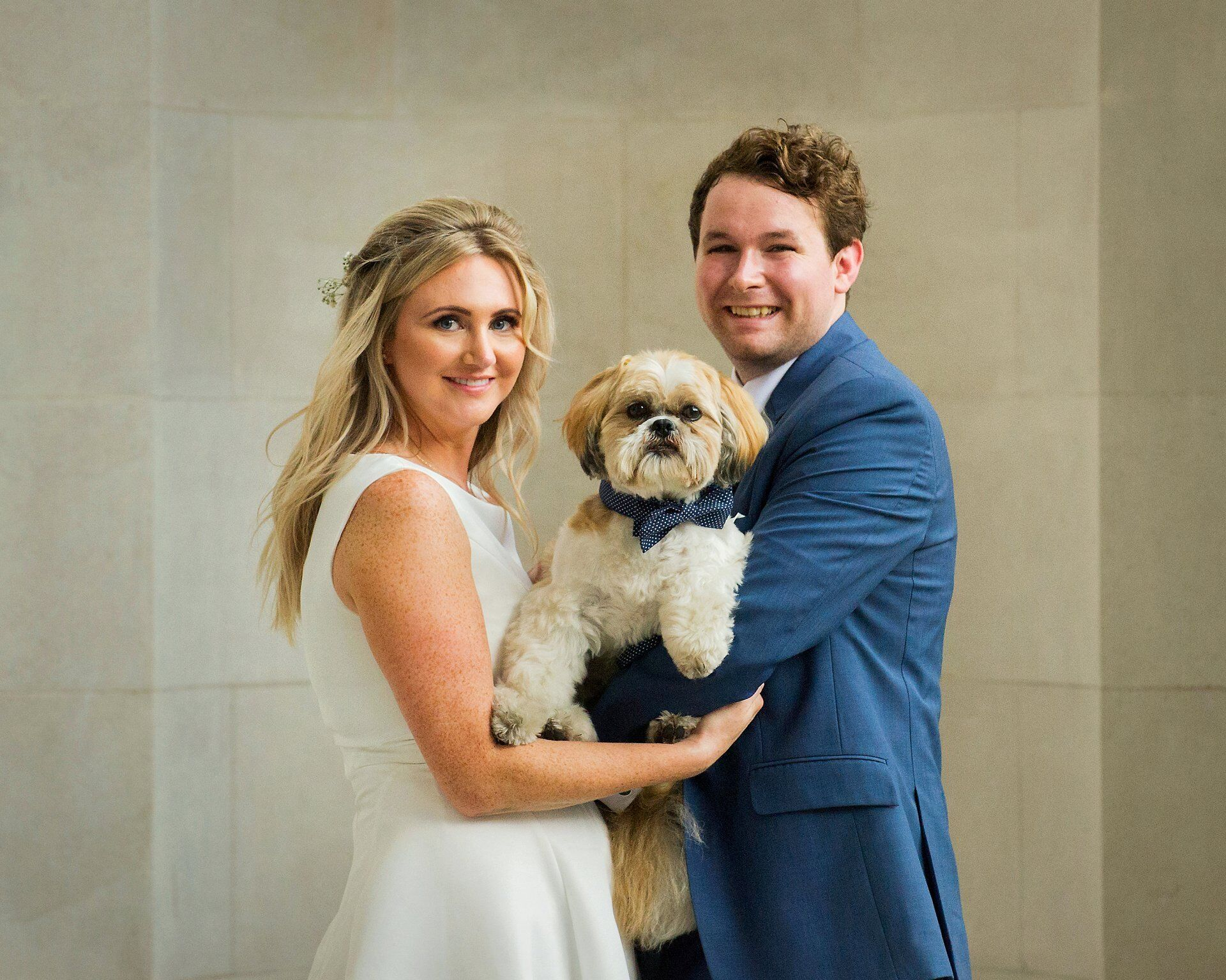 old marylebone town hall wedding dogs bride and groom celebrate their soho room civil wedding with pet shih tzu jasper london wedding photography by the hour
