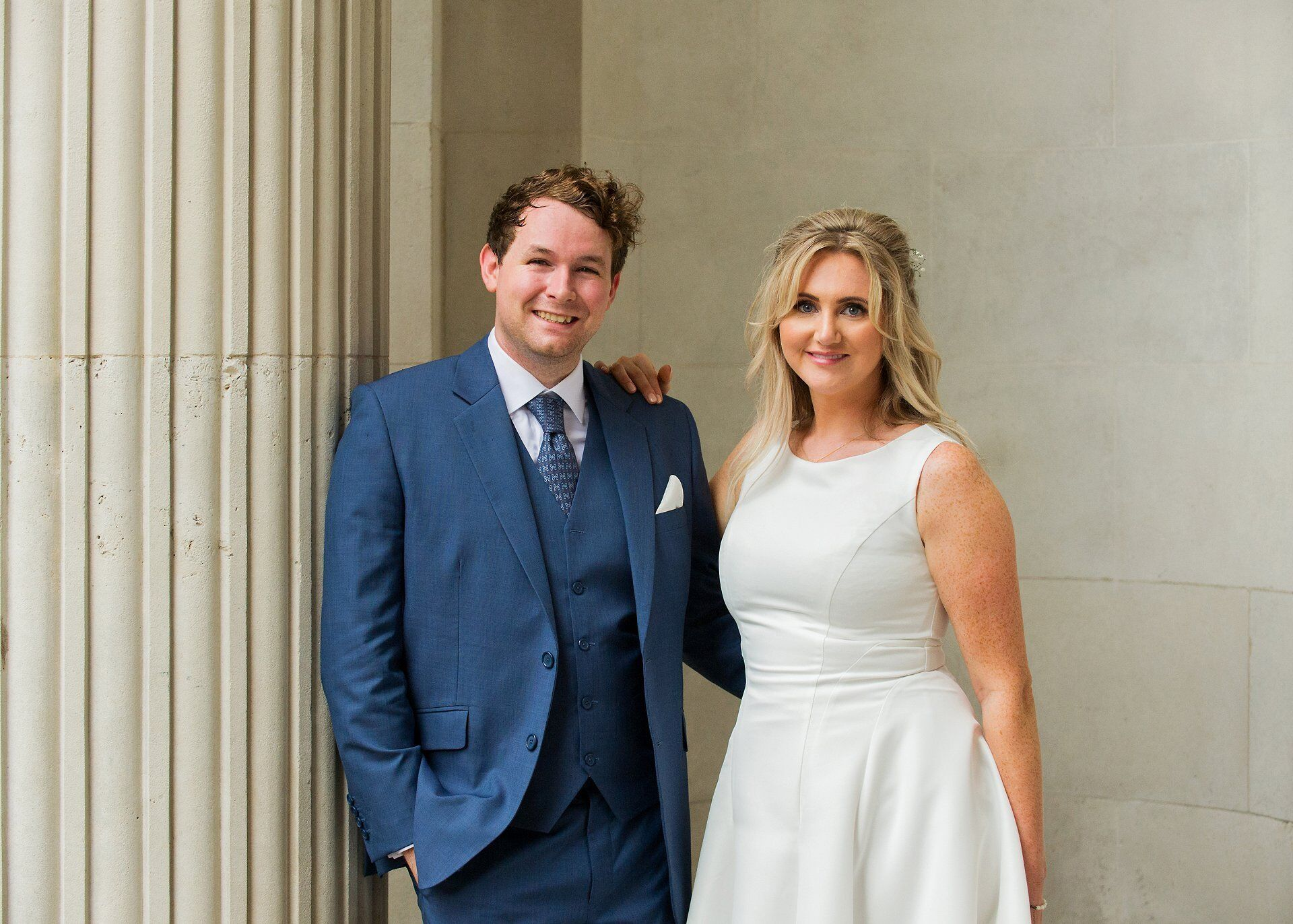 old marylebone town hall wedding photography a bride and groom pose after their 2018 summer heatwave wedding