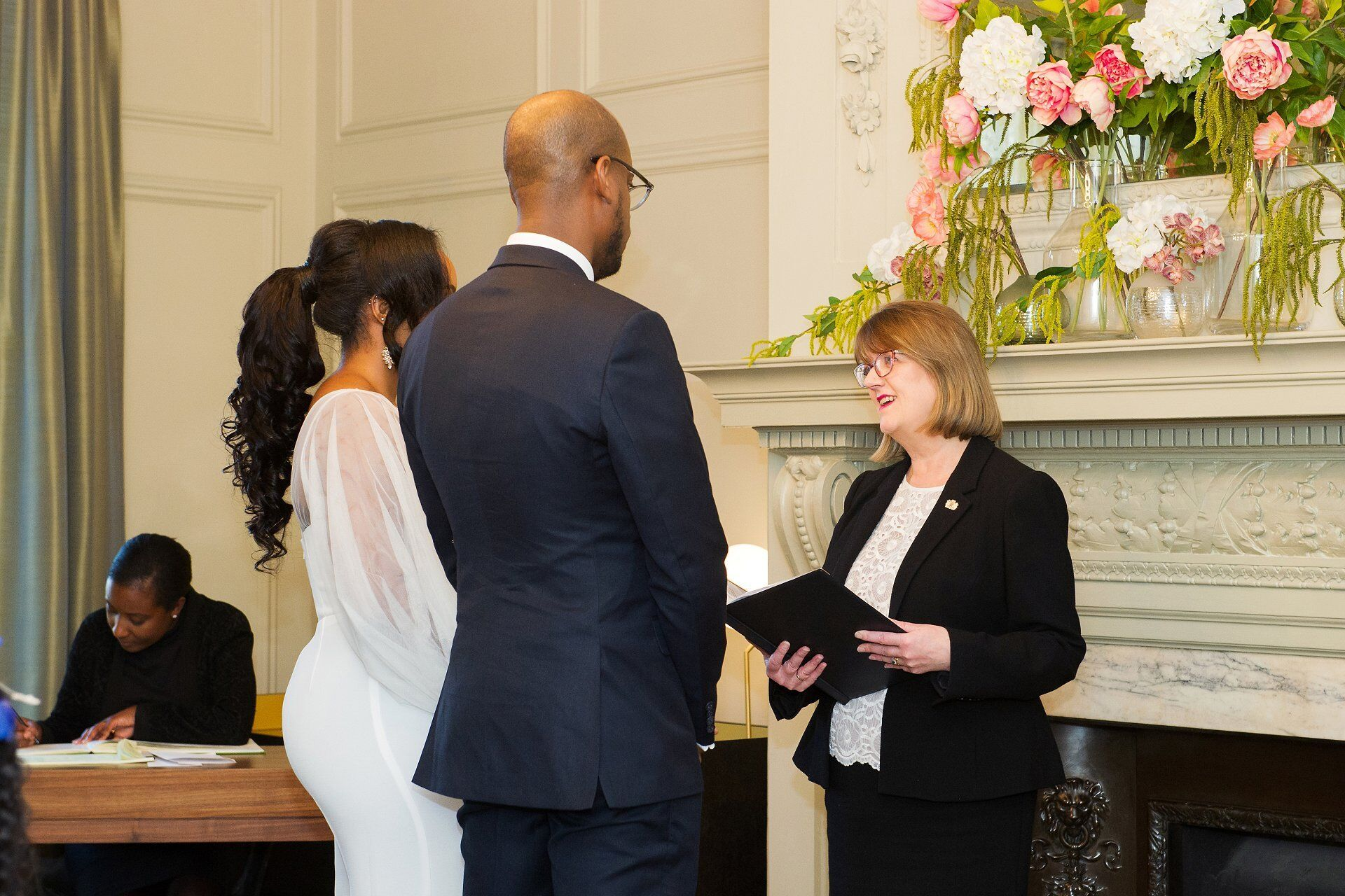 alison cathcart precides over a pimliso room wedding at old marylebone town hall