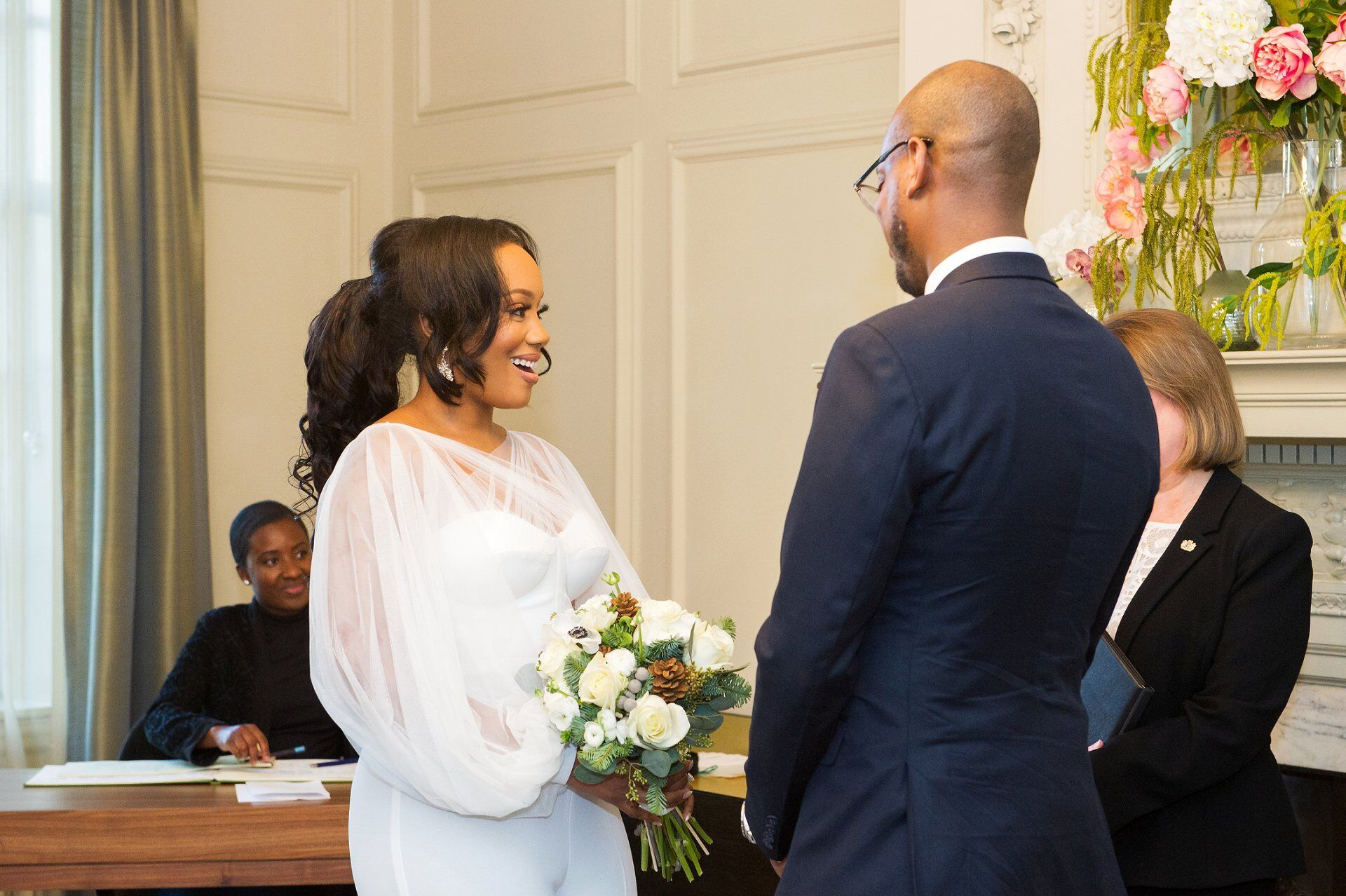 bride smiles broadly at the end of her wedding ceremony in marylebone town hall
