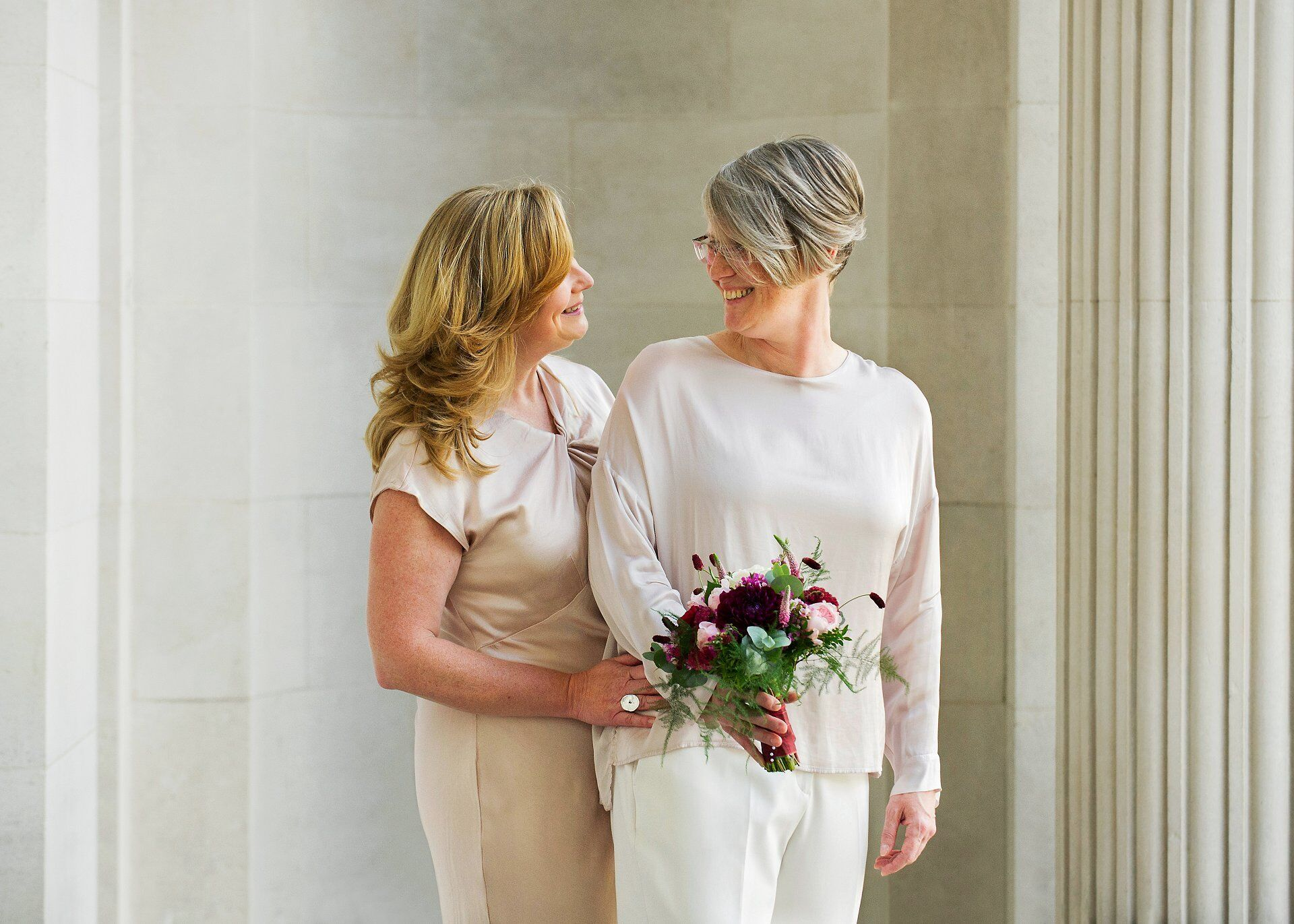 a day to remember westminster register office is a stunning city wedding venue with beautiful light falling on two brides before their civil wedding ceremony