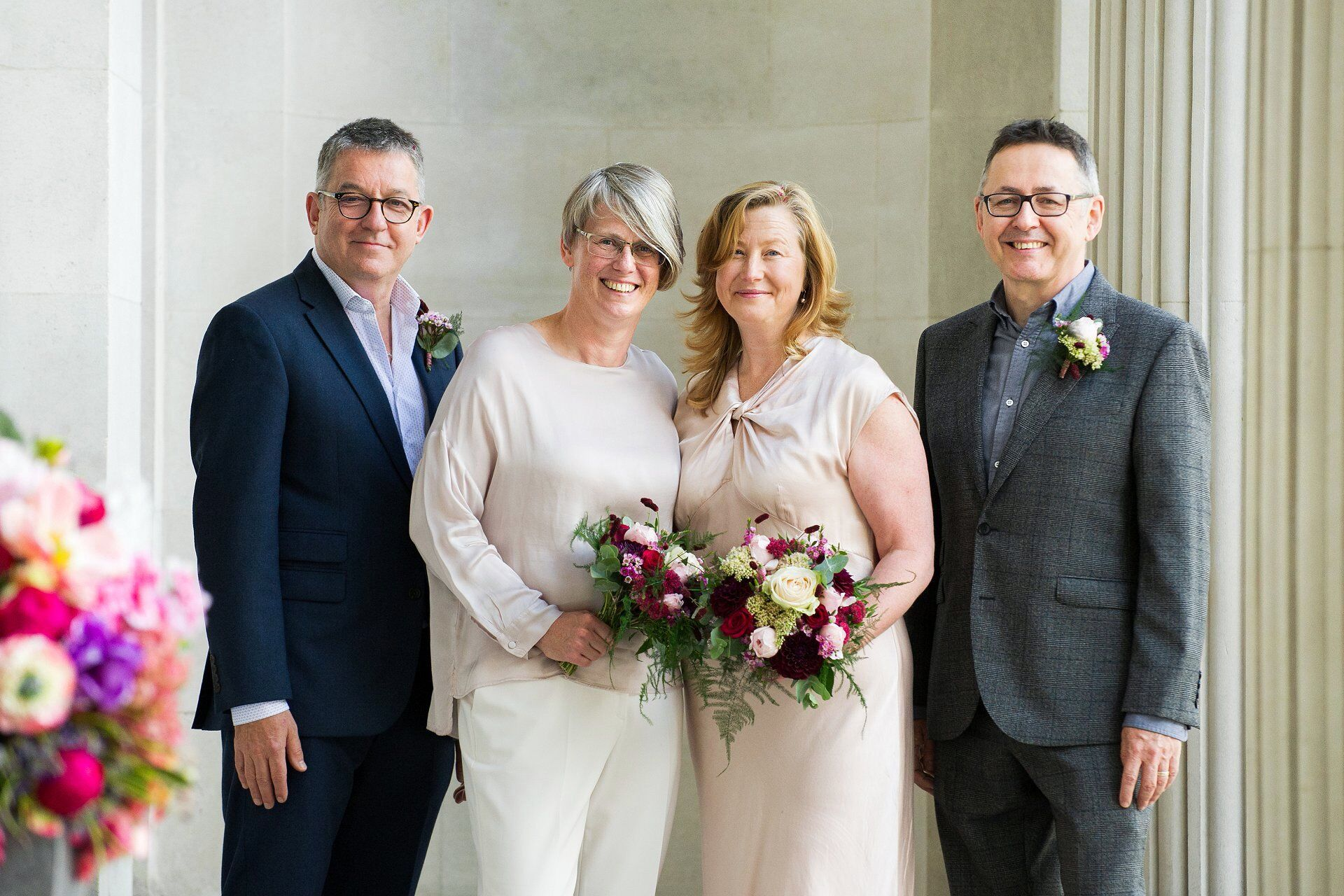 an elopement at old marylebone town hall with two brides and their two guests and witnesses with flowers by titania's garden