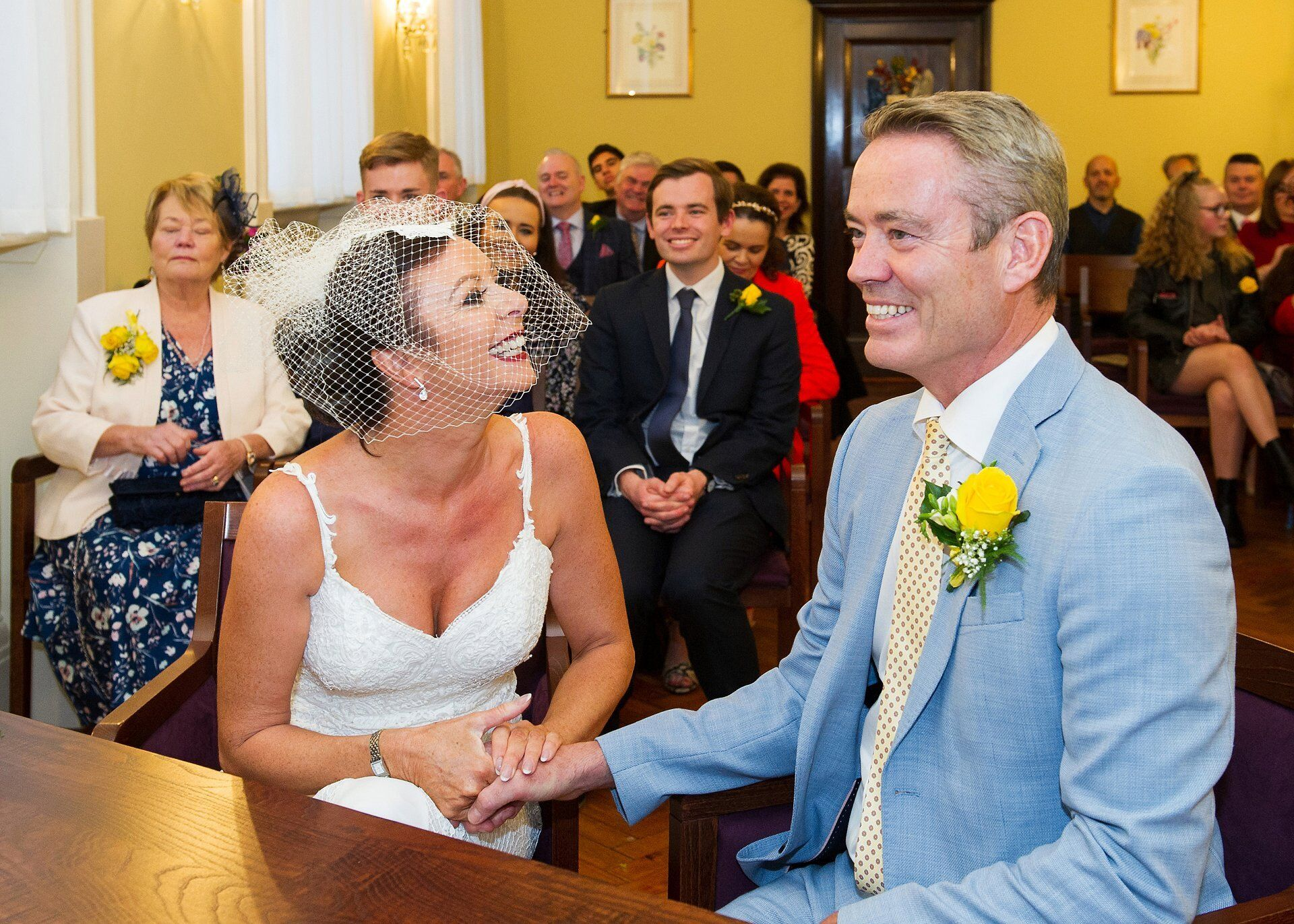 bride and groom giggling during their brydon room ceremony at chelsea register office