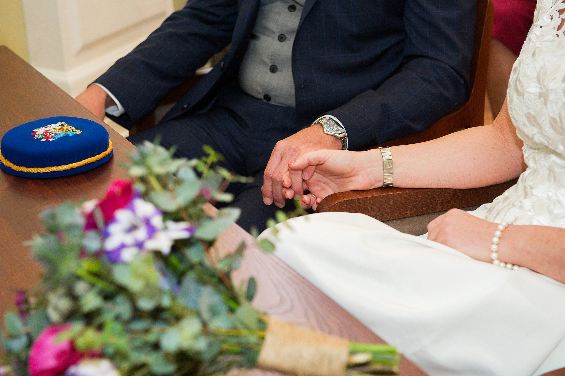 bride and groom hold hands during their rossetti room ceremony
