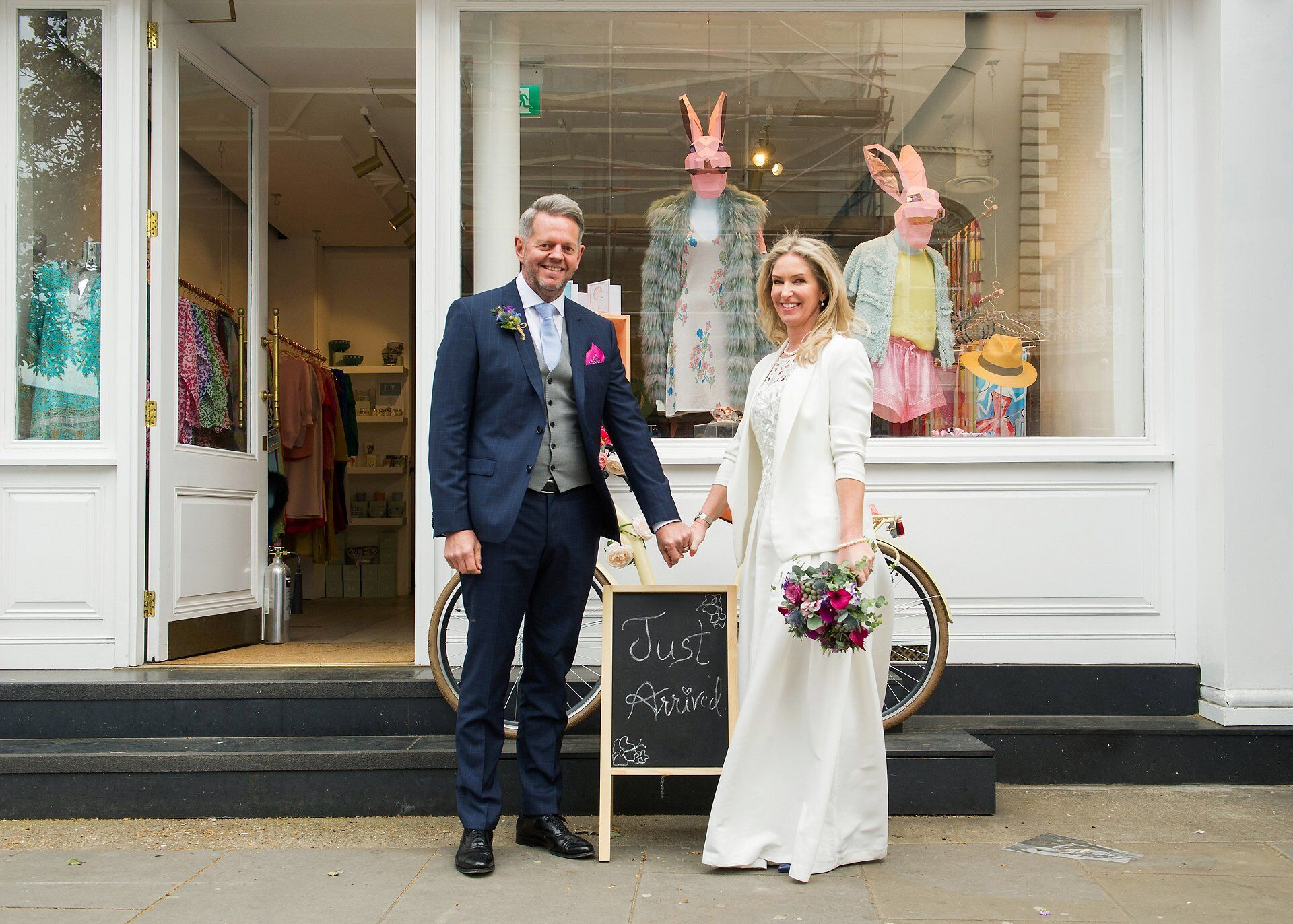 bride and groom in front of a shop on the kings road chelsea