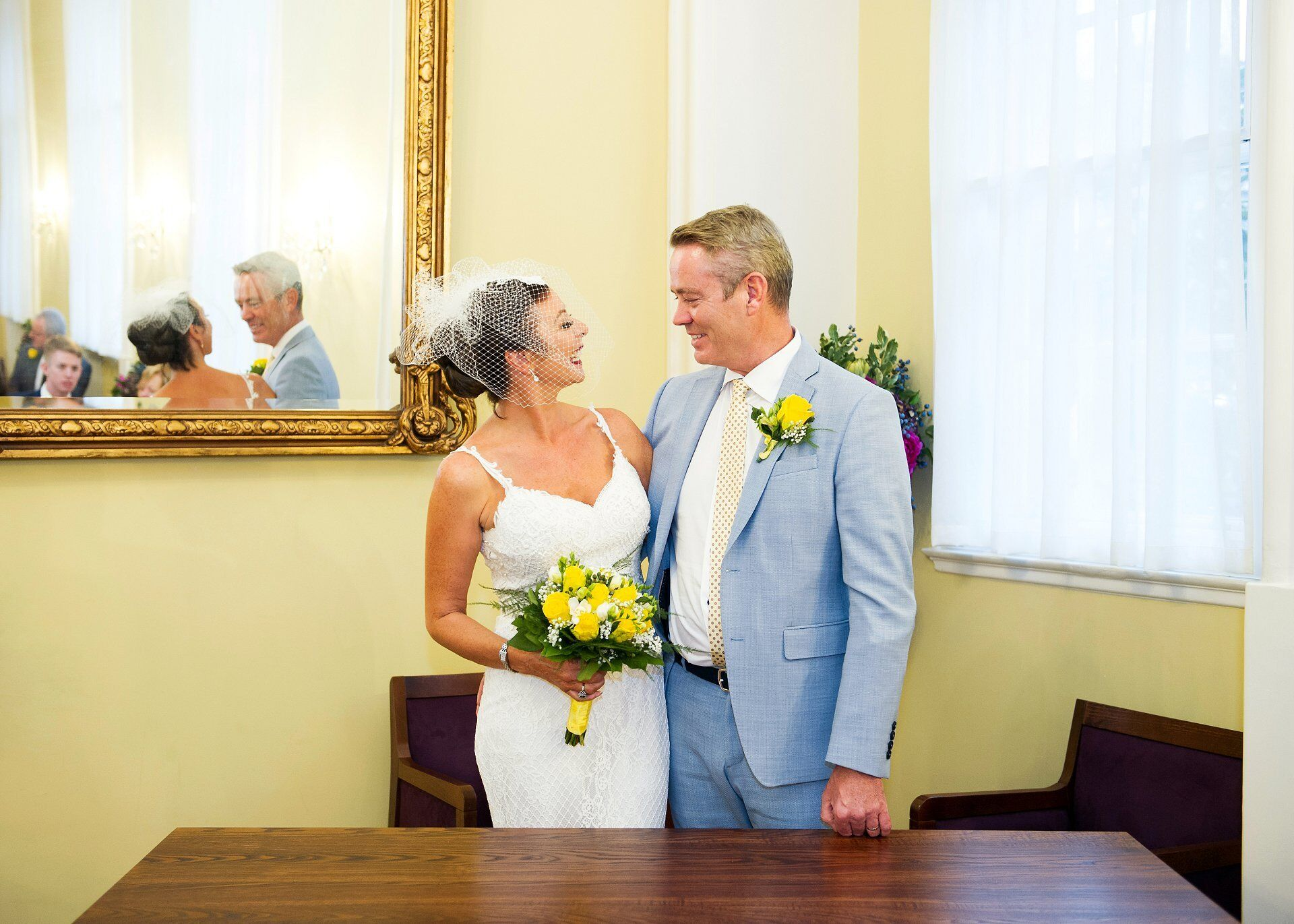 bride and groom in the brydon room at chelsea registry office
