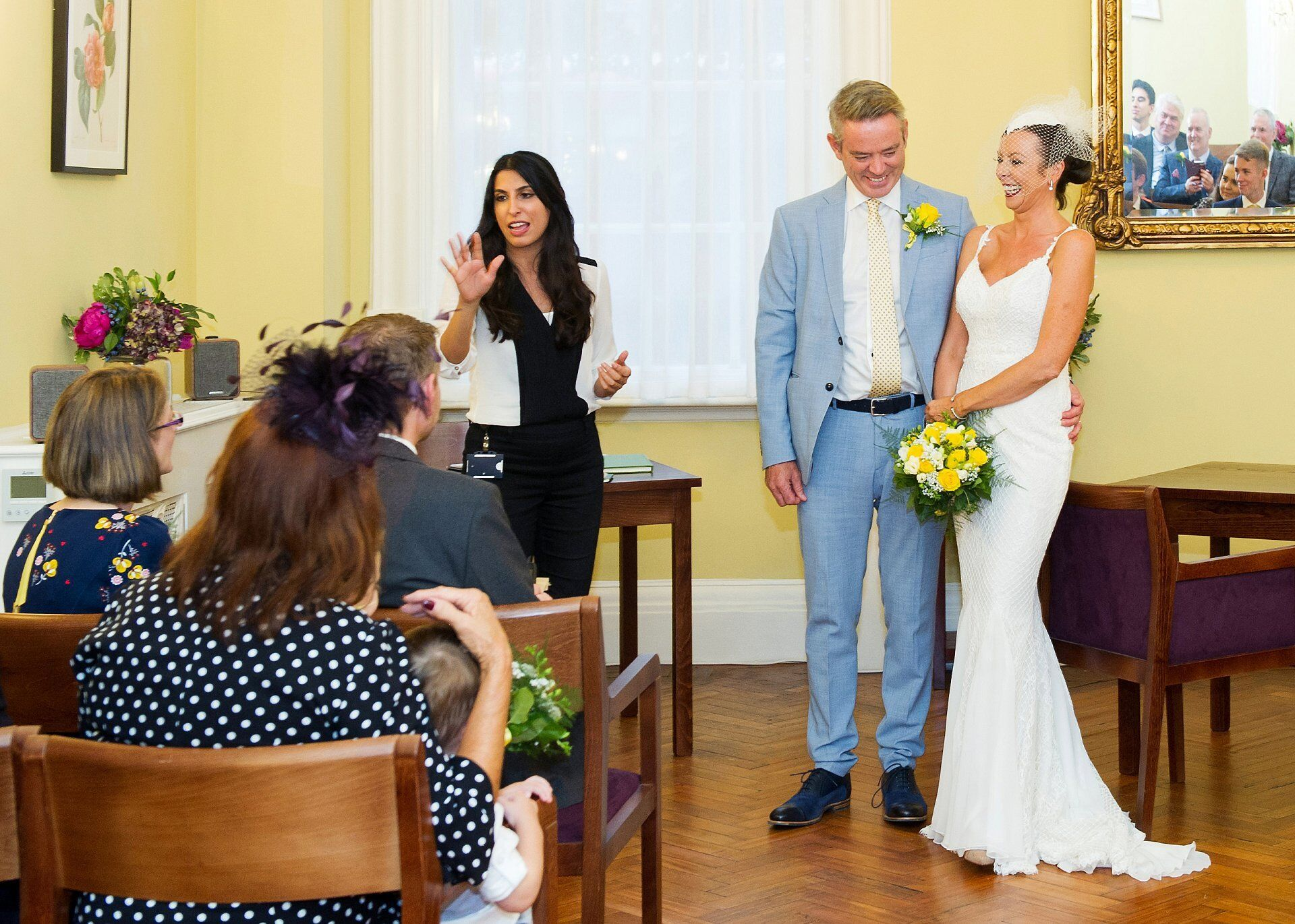 bride and groom just before they leave the brydon room at chelsea old town hall