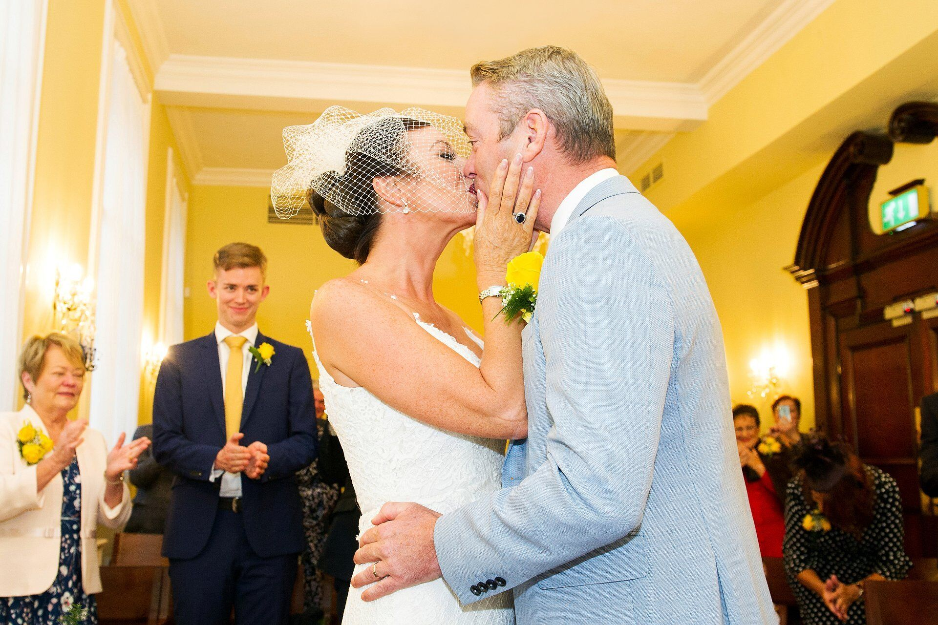Bride and groom kiss in the brydon room at chelsea old town hall