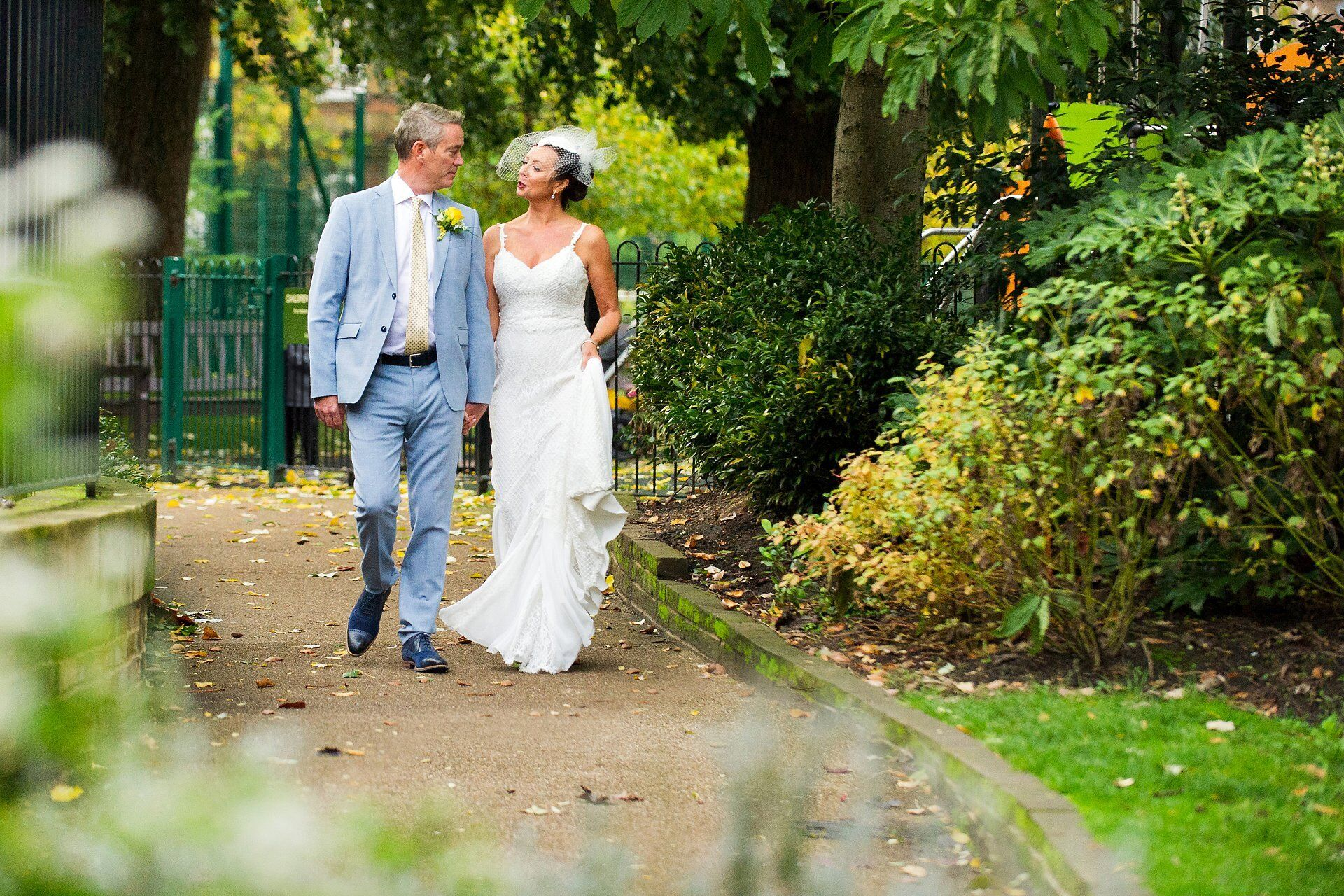 bride and groom walking in st luke's gardens, kensington and chelsea