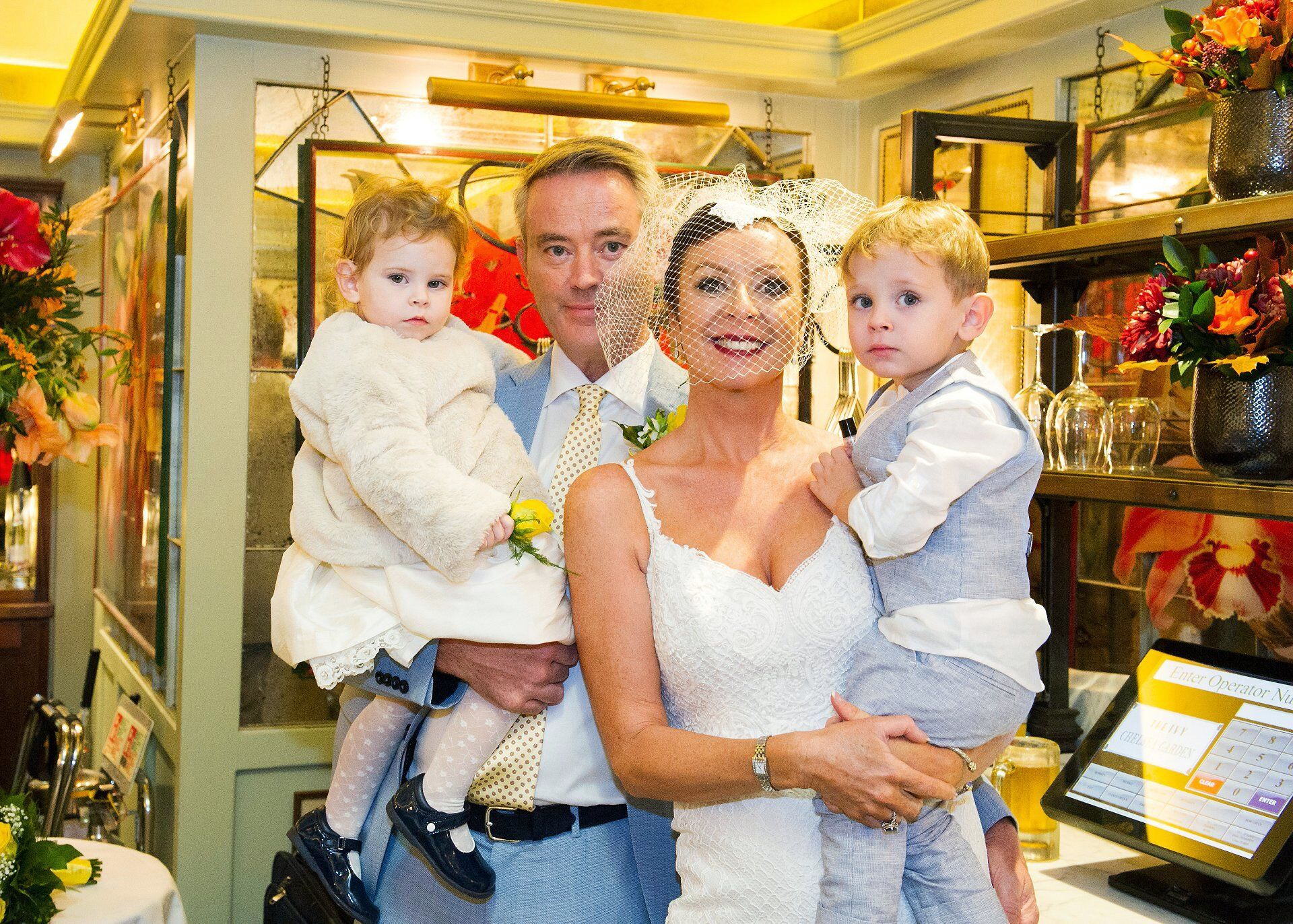bride and groom with children in the eden room at the ivy chelsea garden