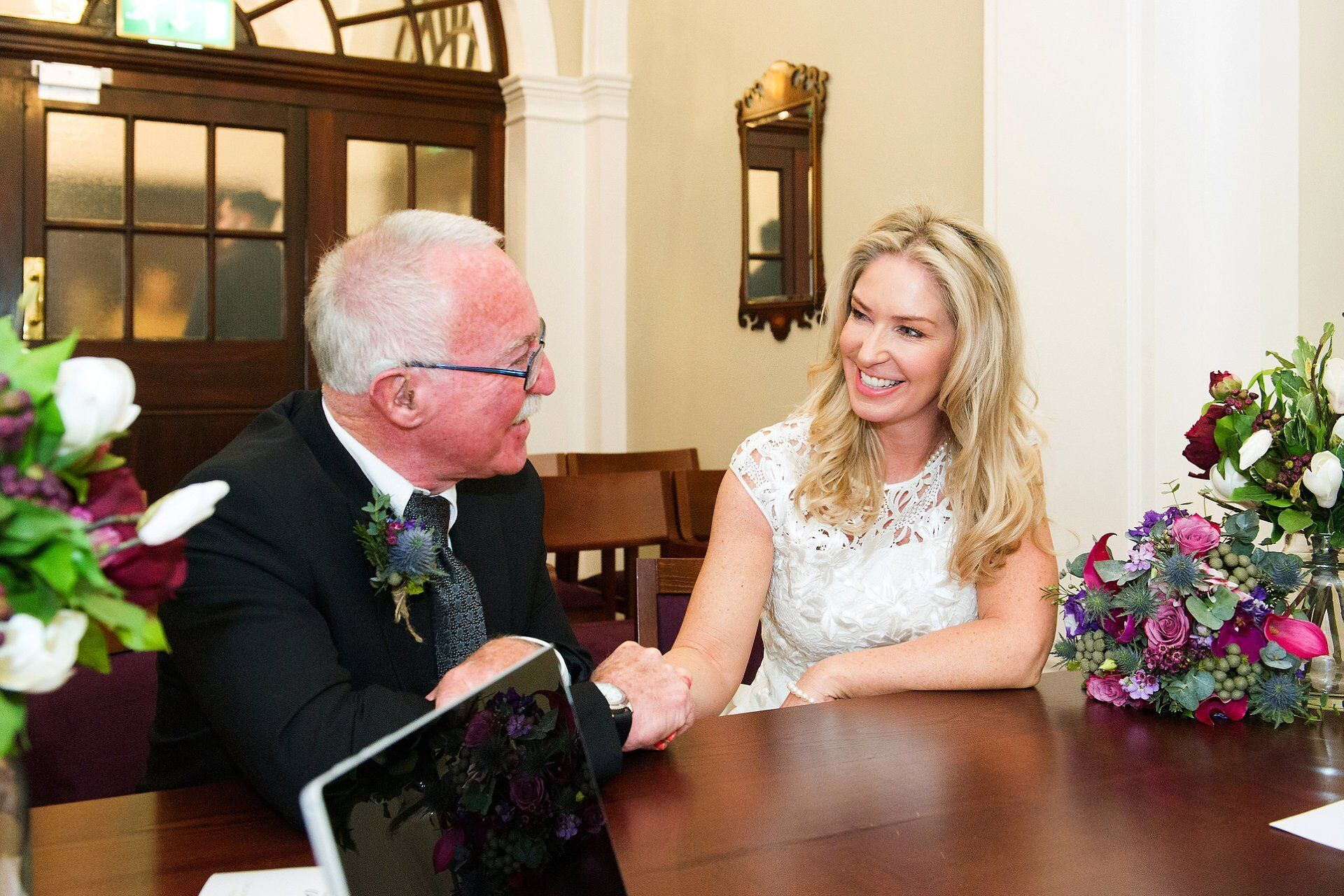 bride and her father in the newly refurbished harrington room at chelsea old town hall during their pre ceremony registrar interview