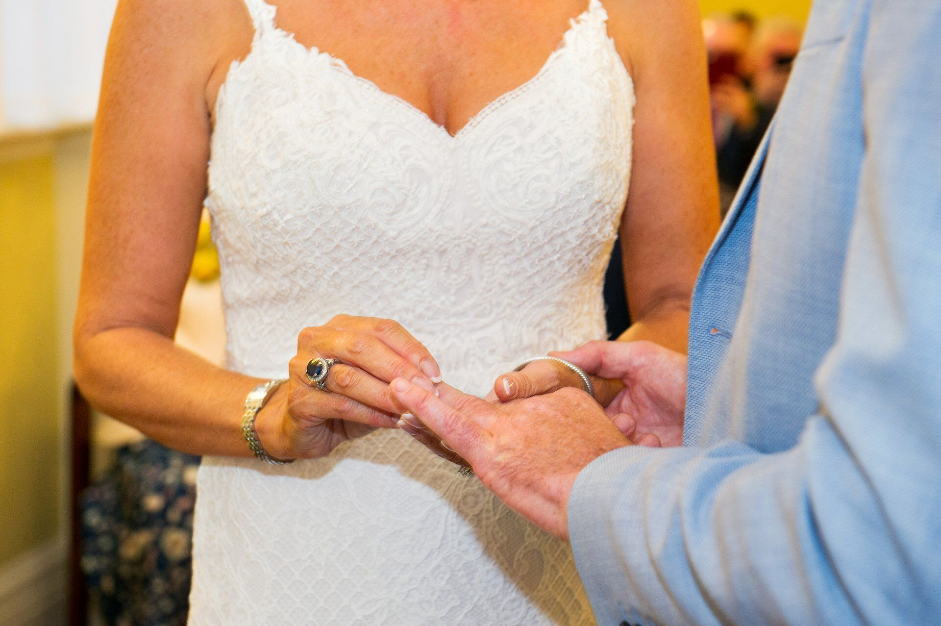 bride places ring on groom's finger during chelsea register office ceremony