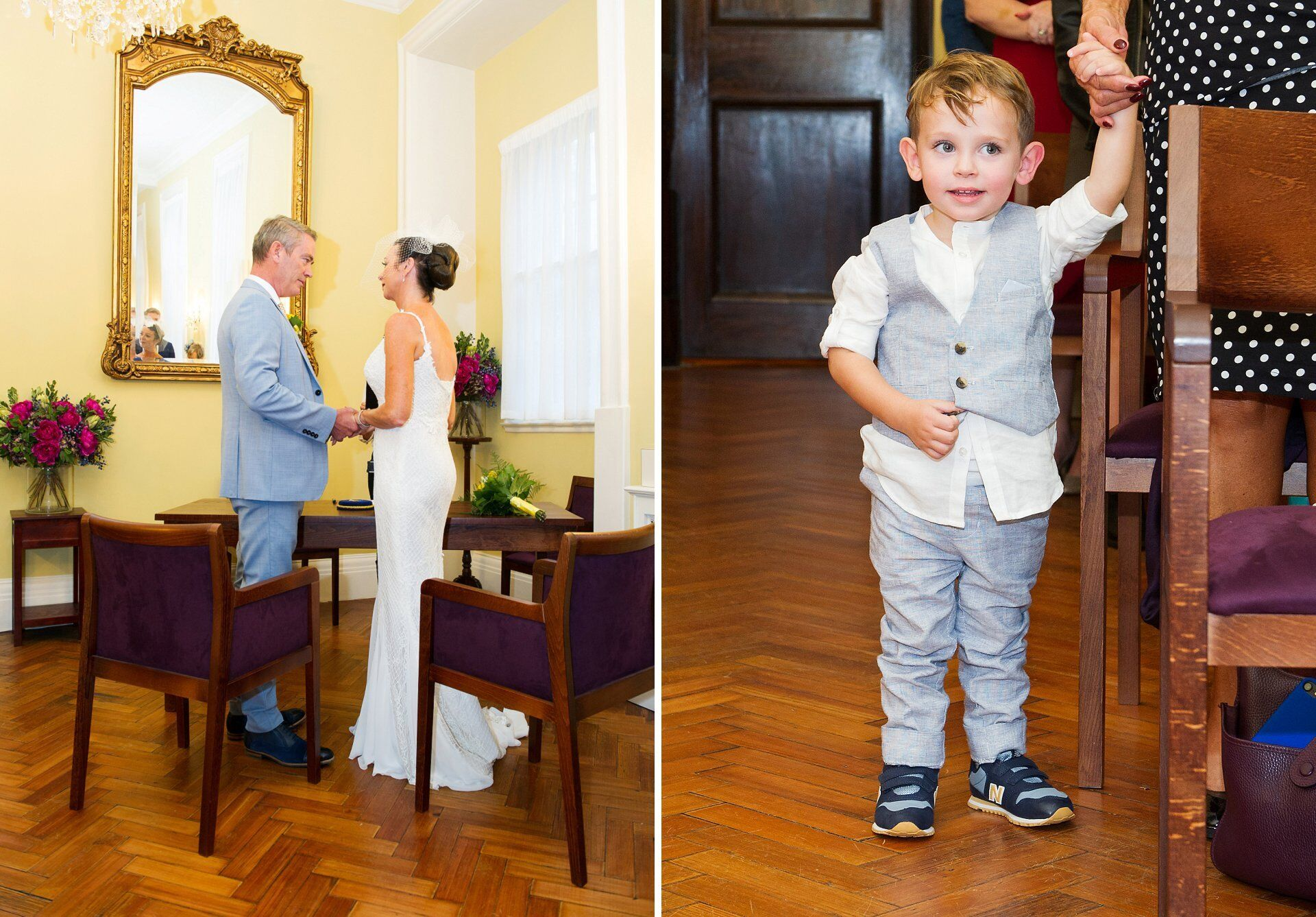 bride's stunning full length fitted lace wedding dress seen from the back of the brydon room with son looking on