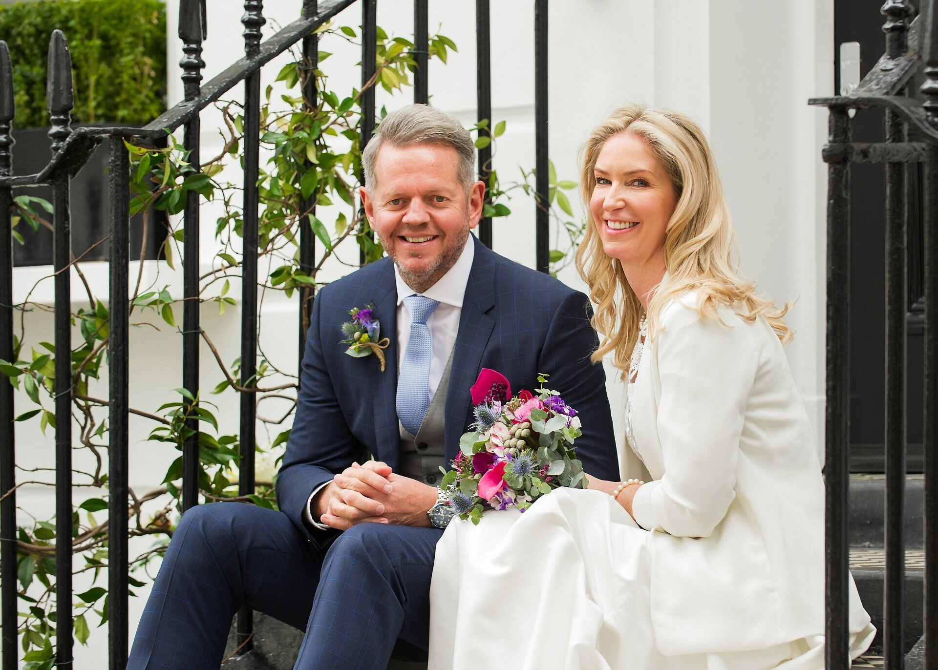 choose expert chelsea old town hall wedding photography for your small chelsea wedding using black railings and white stucco buildings typical of chelsea village