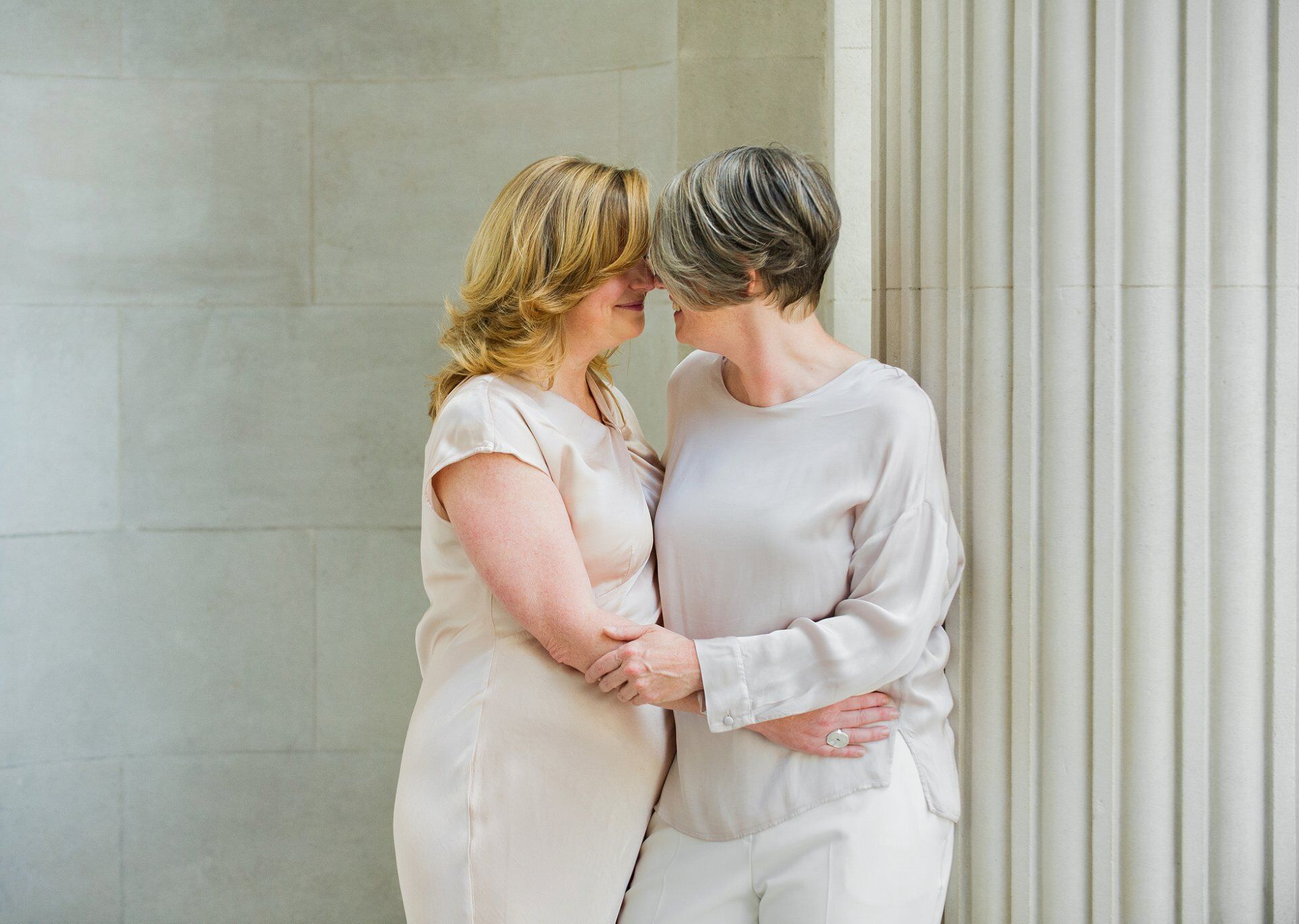 emma and sarah brides under the fluted coloumns at westminster registry office (elopement wedding photography by emma duggan)