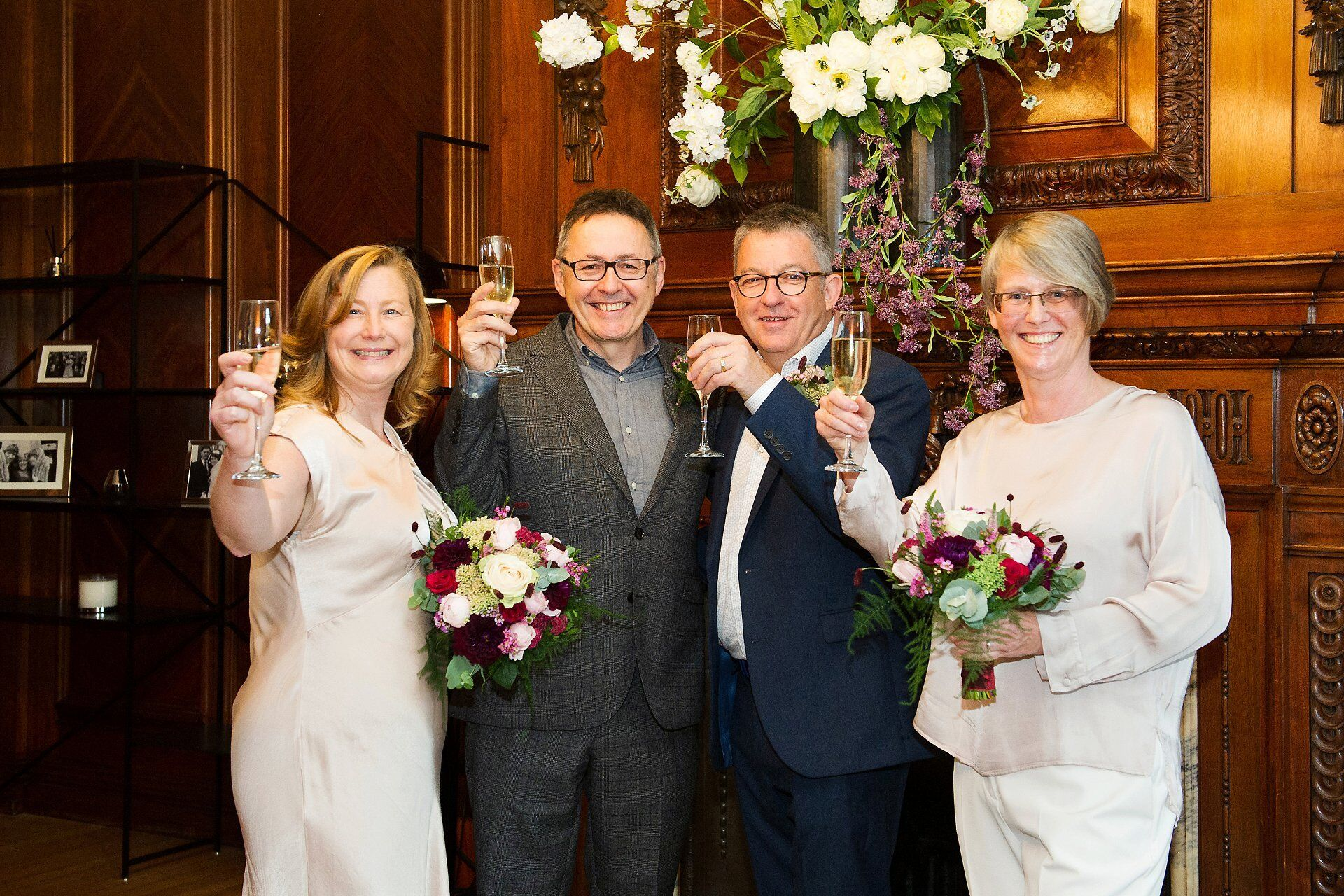 first toast option and paddington room wedding photography at old marylebone town hall showing two brides and their two witnesses for their westminster registry office elopement