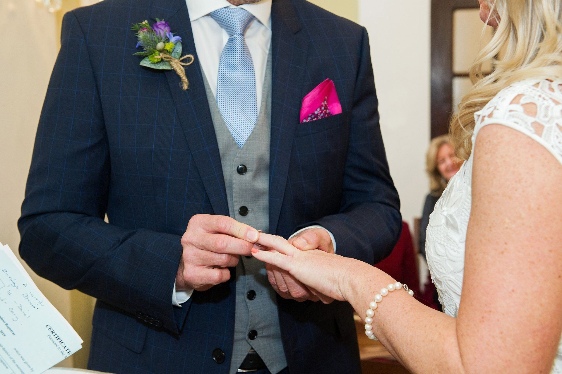 groom places ring on brides finger in the rossetti room at chelsea old town hall