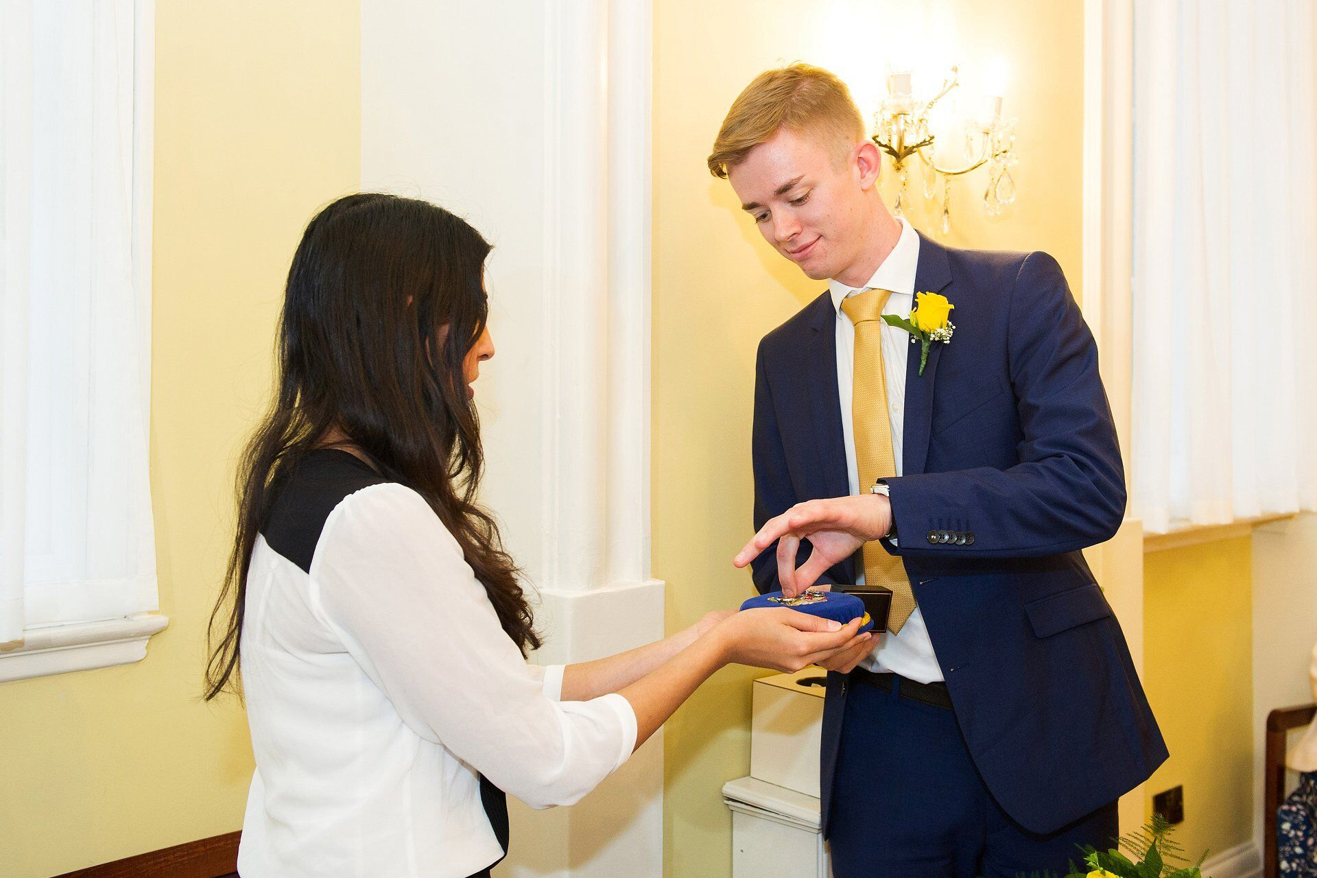 groom's son delivers the wedding rings to the registrar in the brydon room at chelsea
