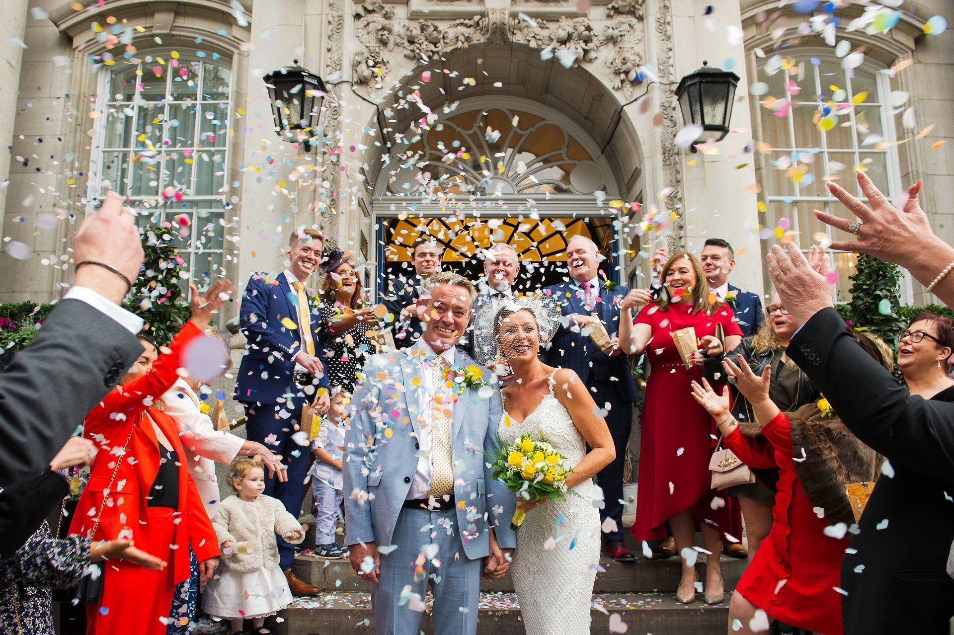 Ivy Chelsea Garden wedding photographer and confetti on the famous Chelsea Old Town Hall steps (Emma Duggan Photography)