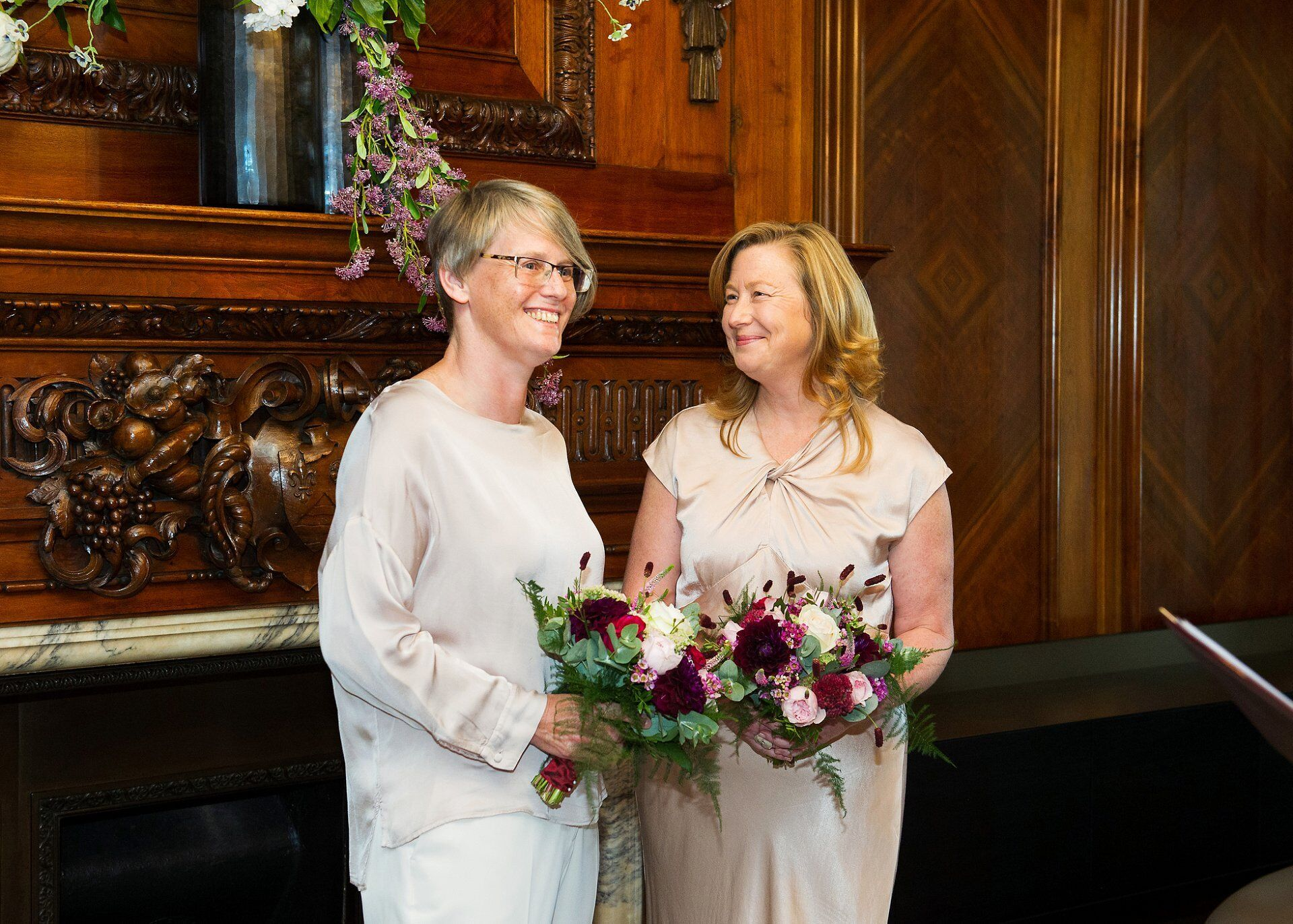 lgbt wedding in the paddington room at old marylebone town hall with two brides wearing gorgeous ghost outfits