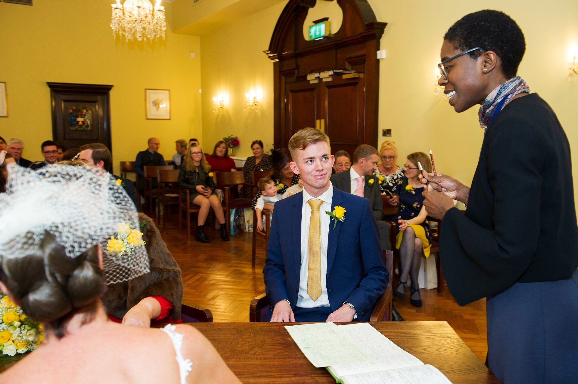 registrar and witness having a moment during a brydon room wedding ceremony
