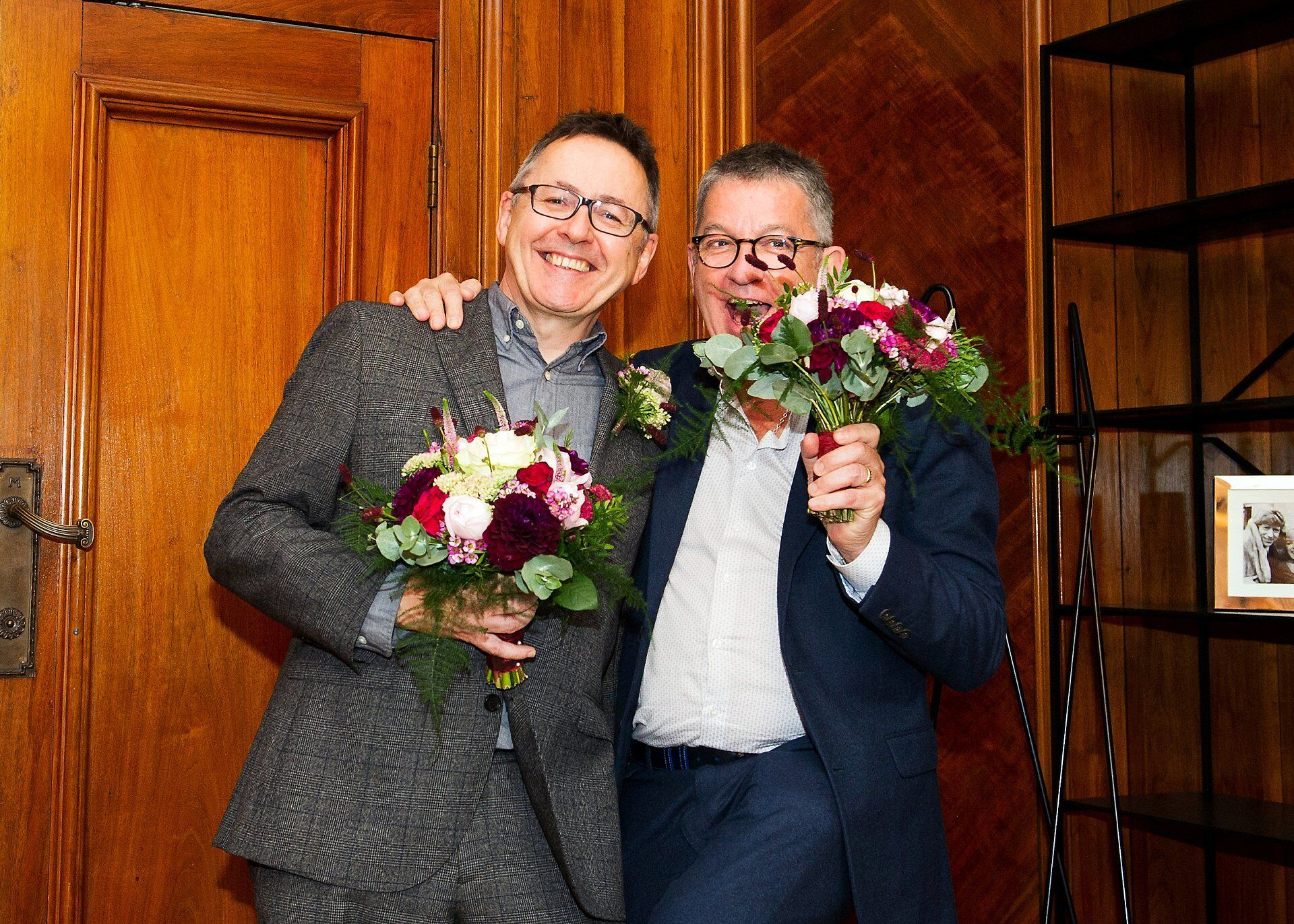 two guests in the paddington room holding the two brides bouquets from tatanias garden in marylebone